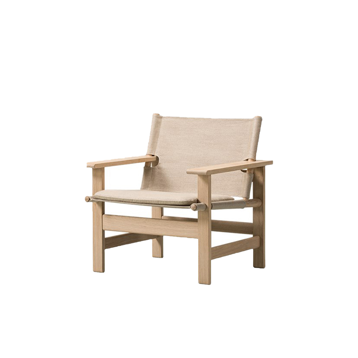 The Canvas Lounge Chair - Canvas teamed with wood define a more casual, down-to earth lifestyle in this simple, structural chair with a strong presence by Børge Mogensen. Reflecting values all the more relevant today, given its broad width that allows people to merge work and play in comfort.  The Canvas Chair exemplifies Børge Mogensen's talent for functionally-driven designs with a focus on simple, structural forms that capture the essence of an idea. With nothing to add or subtract.   Drawing on his preference for natural materials, Mogensen used flat canvas as the seat and back suspended between round pieces of wood, together with his trademark use of horizontal and vertical lines for the frame. The result is contrast and an uncanny sense of balance.   Although it was designed in 1970 as a reaction to flashy furniture from the 1960s, The Canvas Chair takes on even more relevance today, given its earthy informality and honest materials. Boasting an unadorned authenticity which modern audiences find especially appealing.   Prime European oak and linen canvas are both available in black or natural coloured versions, with an optional loose seating cushion in canvas or leather.   One of the last pieces Mogensen designed before his untimely death in 1972, The Canvas Chair has remained in our archives ever since – until now. Whether in a hotel, lounge, retail space or private home, it's a statement piece with a strong presence.  Please enquire for seat cushion  | Matter of Stuff