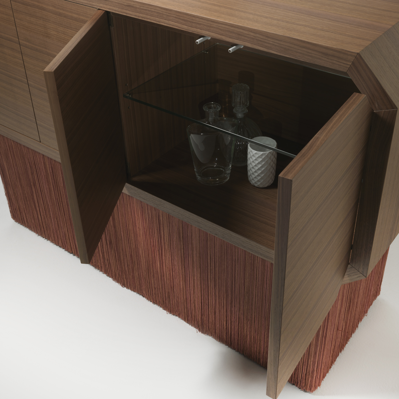 """Sipario Short Cabinet - The inspiration for the Sipario collection arises from a study about Italian theatres: a wooden semi cycle, perspectival off-stages and a deep scenery. Top cabinet is available in Oak or Walnut wood. The fringes are made using a technique called """"Tripolino"""". Other colour available for bespoke orders. 
