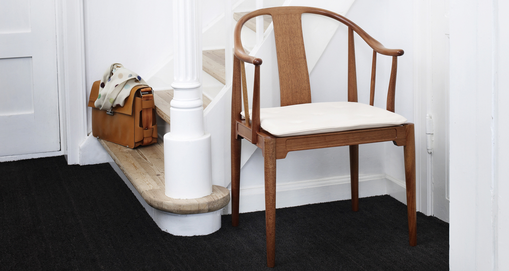 China Armchair - <p>The China Chair™ was designed by Hans J. Wegner, in 1944 and it stands out as the only solid wood chair in the Fritz Hansen collection. Wegner found inspiration for this timeless classic in Chinese chairs from the 17th and 18th Centuries. </p> <p>The China Chair™ epitomizes his lifelong quest to understand the nature of wood and explore its possibilities. In Wegner's modern interpretation of ancient Chinese chairs, he unfolds his talent as a wood craftsman along with his flair for expressive and sculptural functionalism. </p> <p>The frame is made of solid wood in matt lacquered cherry or black coloured ash. The seat cushion is reversible and made of leather with buttons.</p>  | Matter of Stuff