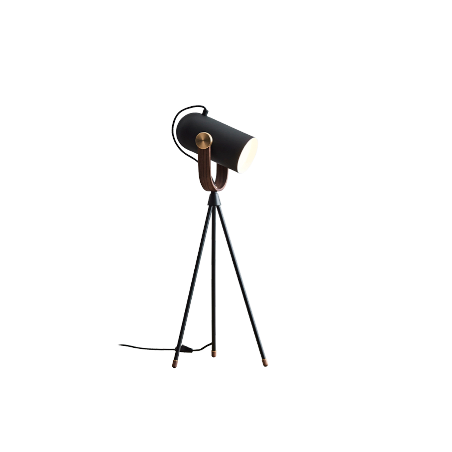 Carronade High Table Lamp - Our brand-new CARRONADE High Table in black has been fashioned into a miniature version of the CARRONADE High floor lamp, which includes the distinctive slender tripod legs and tilting head. CARRONADE High Table has the exact features of the series, where walnut wood and brass details support a black metal head that has a diffuser for optional use. A fantastic fashionista amongst the usual LE KLINT suspects!  Carronade high table lamp comes in a black or sand painted aluminium finish with brass or aluminium metal discs and American walnut or oak details. All models are fitted with LED light bulbs.   | Matter of Stuff