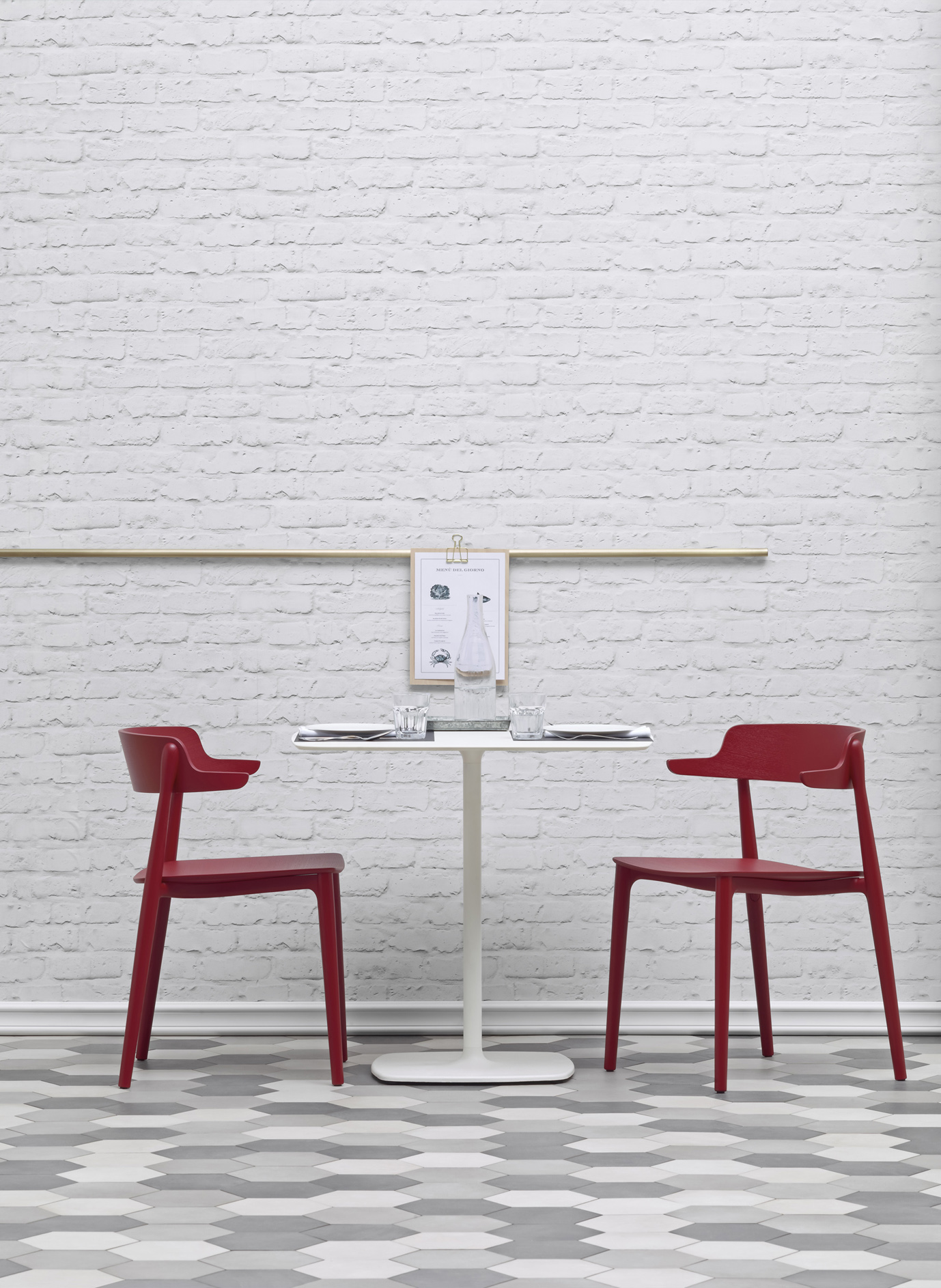 Nemea Chair with Armrest - <p>Nemea is a collection of classically-shaped seatings, whose visible, light structural elements seem to be smoothed by time, like findings from the Ancient Greece. The armchair seems to extend into an athletic pose, with its sinuous legs in solid ash grafted to the die-casted aluminium frame placed under the plywood seat.<br />