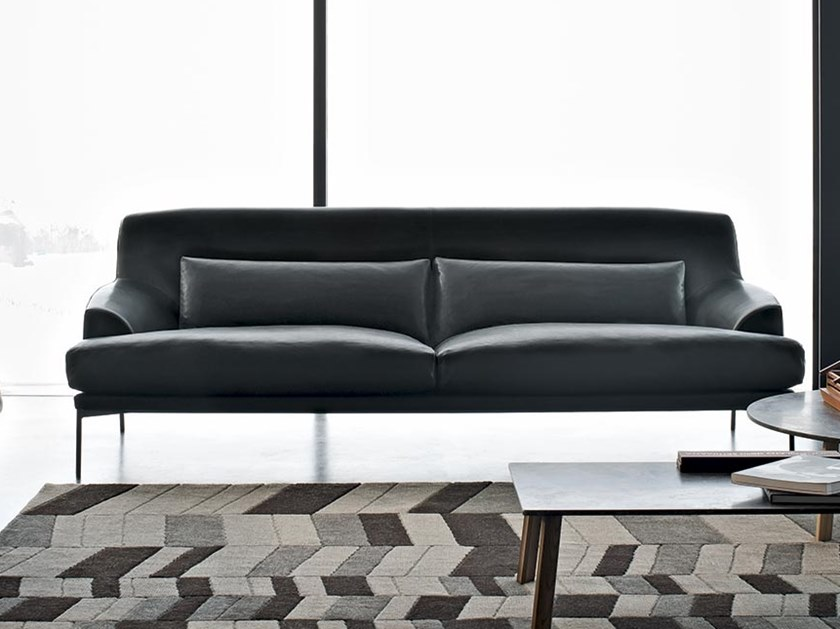 Montevideo Sofa - Carefully designed shapes and sizes for all-round comfort: this is the guiding principle behind the Montevideo sofa. Armrests and backrest trace a soft and cosy outline, complete with feather cushions supporting your lower back. Ergonomic and elegant, the Montevideo sofa is also paired with a matching armchair. A soft, enveloping frame that warm accommodates the body, a feather cushion to be arranged at will for a more customized comfort: this is the Montevideo armchair, the net result of aesthetic and ergonomic principles and designed for a variety of settings, either as stand-alone or combined with its matching sofa.  This sofa comes in three sizes. Fully removable cover. Additional cover is available. Please enquire for more information. | Matter of Stuff