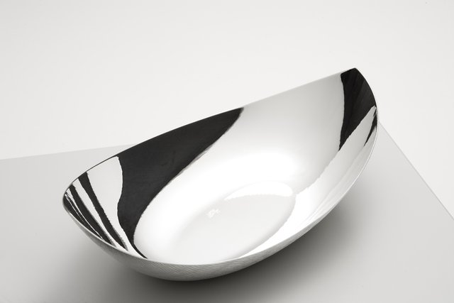 Magnolia Bowl - A perfectly formed and crafted silver bowl, the Magnolia screams class and elegance and sits perfectly on a dining table or as ornamental decoration in your home.  The eye is attracted to the flowing lines and smooth edges of the bowl, created from silver alloy or sterling silver, making an extremely aesthetically pleasing product. | Matter of Stuff