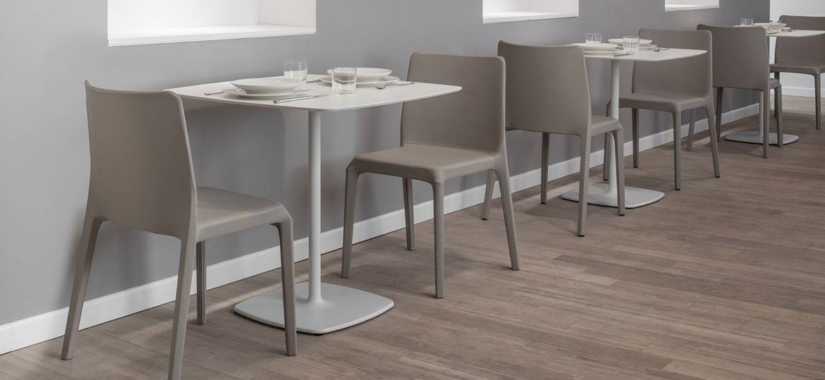 Blitz Stackable Polycarbonate Chair - Blitz is a chair with clean lines and essential structure. Stackable polycarbonate chair available in various colors, full color or transparent. The seat is etched and can accommodate a slightly recessed padding and upholstered in various fabrics. | Matter of Stuff