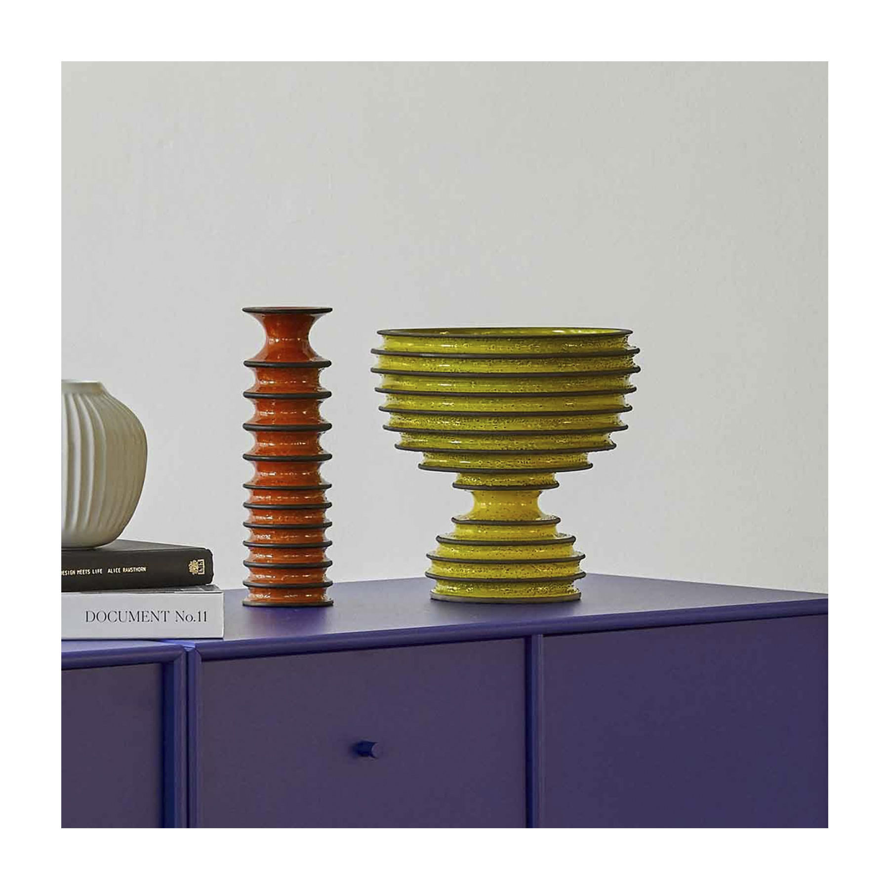 Revolver Orange Goblet - A traditional design dressed in a stylish contemporary suite, this ceramic goblet is part of the exclusive Revolver Collection, showcased at Milan Design Week in 2019. The hourglass-shaped, orange-hued silhouette features a spacious bowl resting on a convex base, both distinguished by a deeply ribbed texture accented by brown edges.    Matter of Stuff