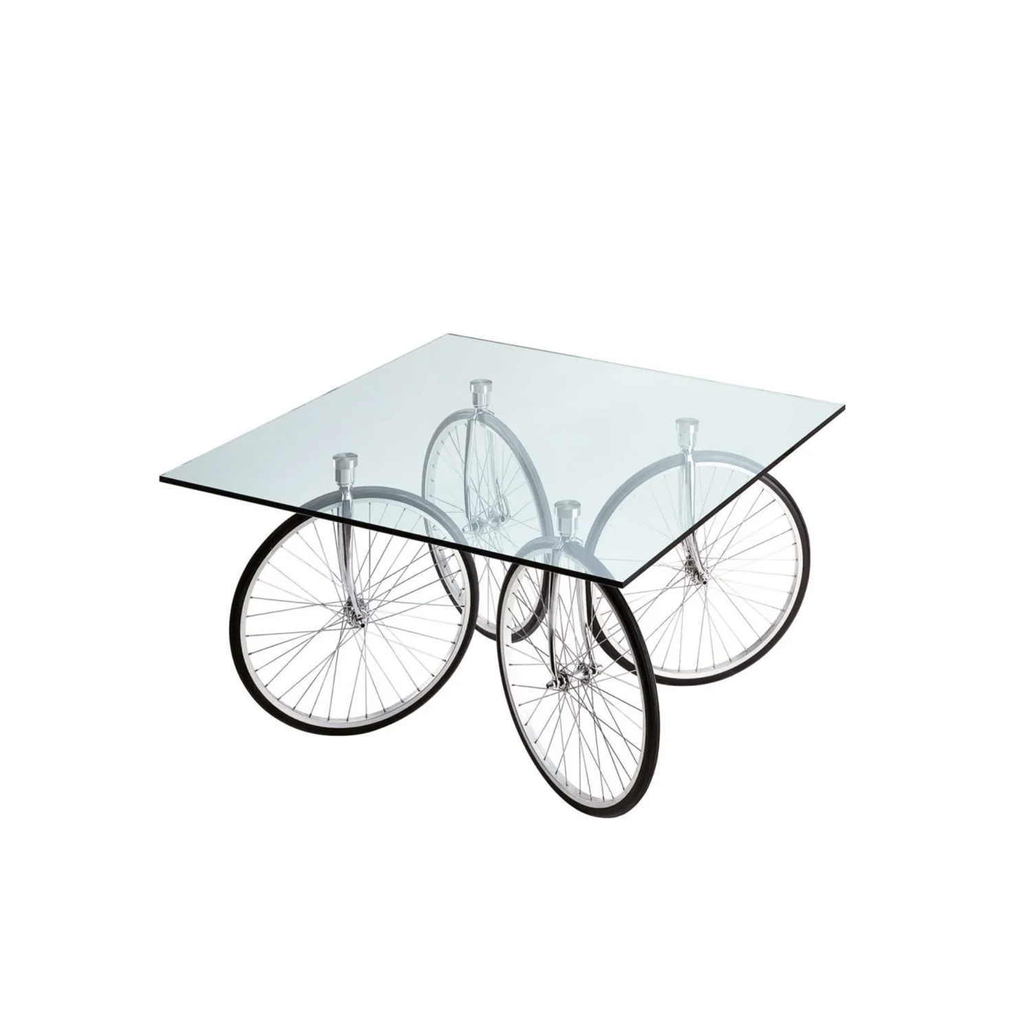Tour Table - Tour is the evolution of the Table with Wheels. Again with wheels, but in this case taken from bicycles, it was a surprising piece.   Table with ground float-glass top. Rotating wheels fixed to the top by four stainless steel plates. Chromium-plated brackets. All-rubber wheels. | Matter of Stuff