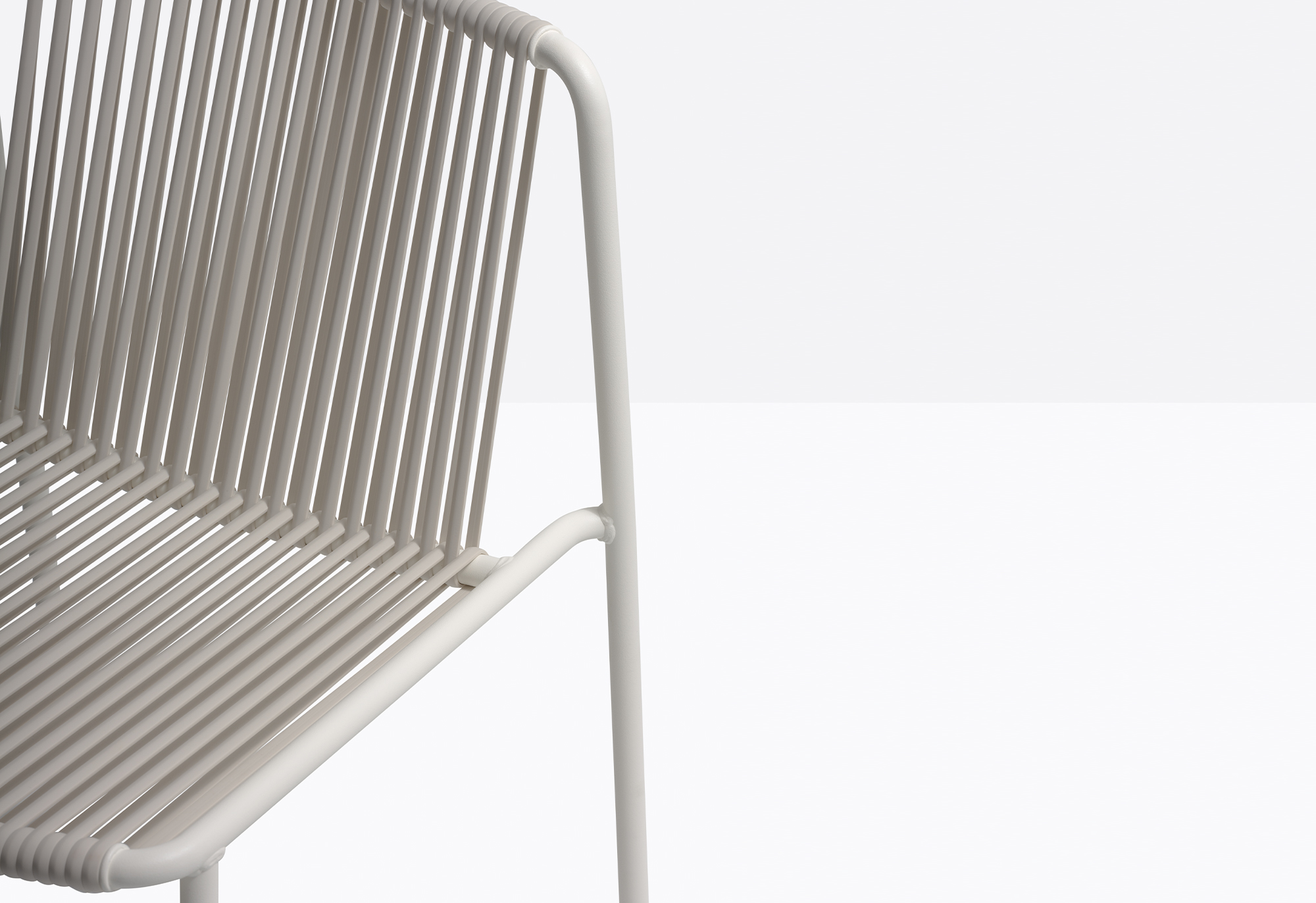 Tribeca Chair - Tribeca takes us back in time with a modern reinterpretation of classic Sixties patio chairs made from steel and woven material. Chair with Ø2cm tube structure powder coated for outdoor use, backrest and seat in woven extruded PVC with a nylon core. Specifically designed for outdoor use. Stackable.  | Matter of Stuff