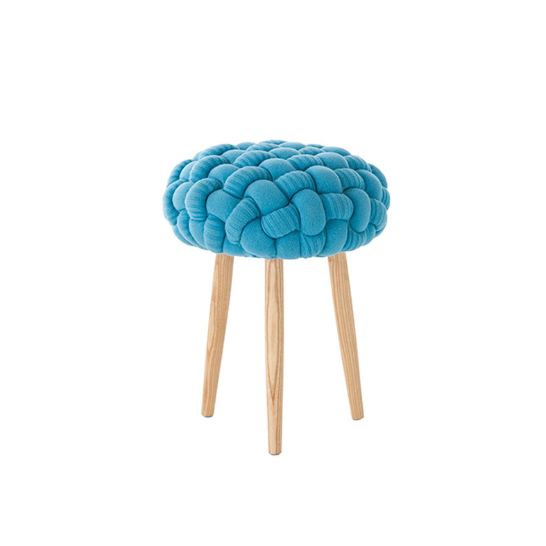 Knitted Blue Stool - <p>Craft, with a touch of magic. Inspired by real stitches and woven yarns, these knitted stools magnify the concept and make it into a completely new item: a comfy seat. This stool has been hand knitted and due to the handmade nature of the GAN product, slight variations in size, colour, finish are normal. </p>