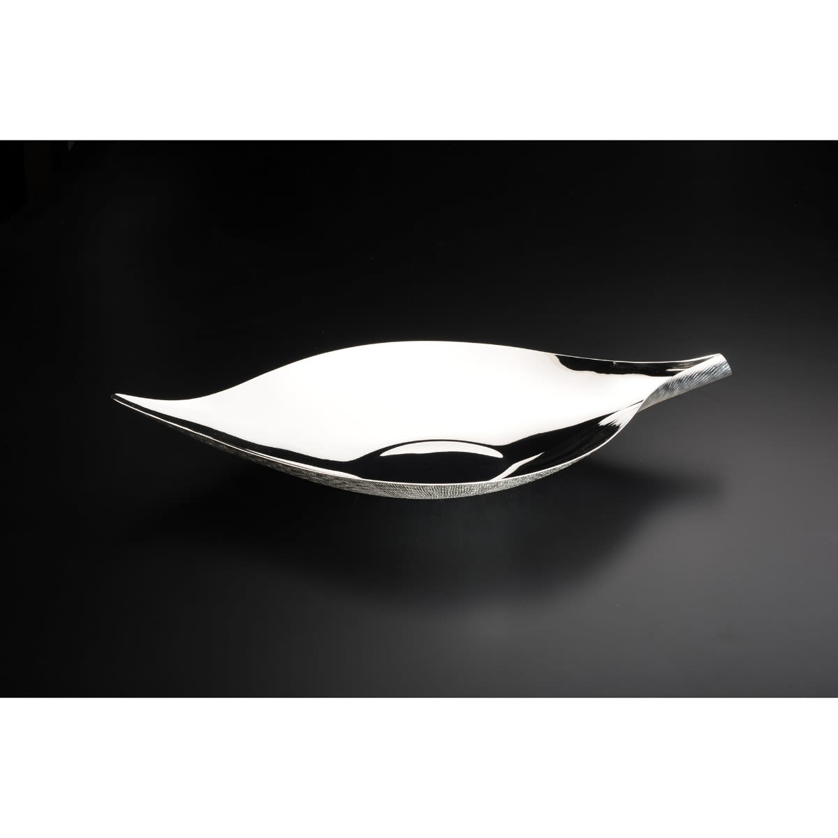 Leaf Bowl - Moulded using expert craftsman techniques, this bowl, as in its name, recalls the curving lines of the leaf. The internal surface is smooth and polished, while the exterior is entirely hammered by hand to create the texture of bark. Thus, the Leaf Bowl manages to interpret the subtle forms and patterns seen in nature in a stylish way that elegantly compliments a modern home.  The result is a piece which radiates the balance and harmony that is felt in a natural environment. Available in Sterling Silver and a silver-plated alloy, it makes it a compelling addition to any interior.  | Matter of Stuff