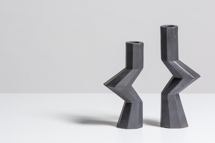 Fortress Militia Candlesticks Iron - <p>Designer Lara Bohinc explores the marriage of ancient and futuristic form in the new Fortress Vase range, which has created a more complex geometric and modern structure from the original inspiration of the octagonal towers at the Diocletian Palace in Croatia. The resulting hexagonal blocks interlock and embrace to allow the play of light and shade on the many surfaces and angles. These are handmade from ceramic in a small Italian artisanal workshop and come in different finishes</p>  | Matter of Stuff