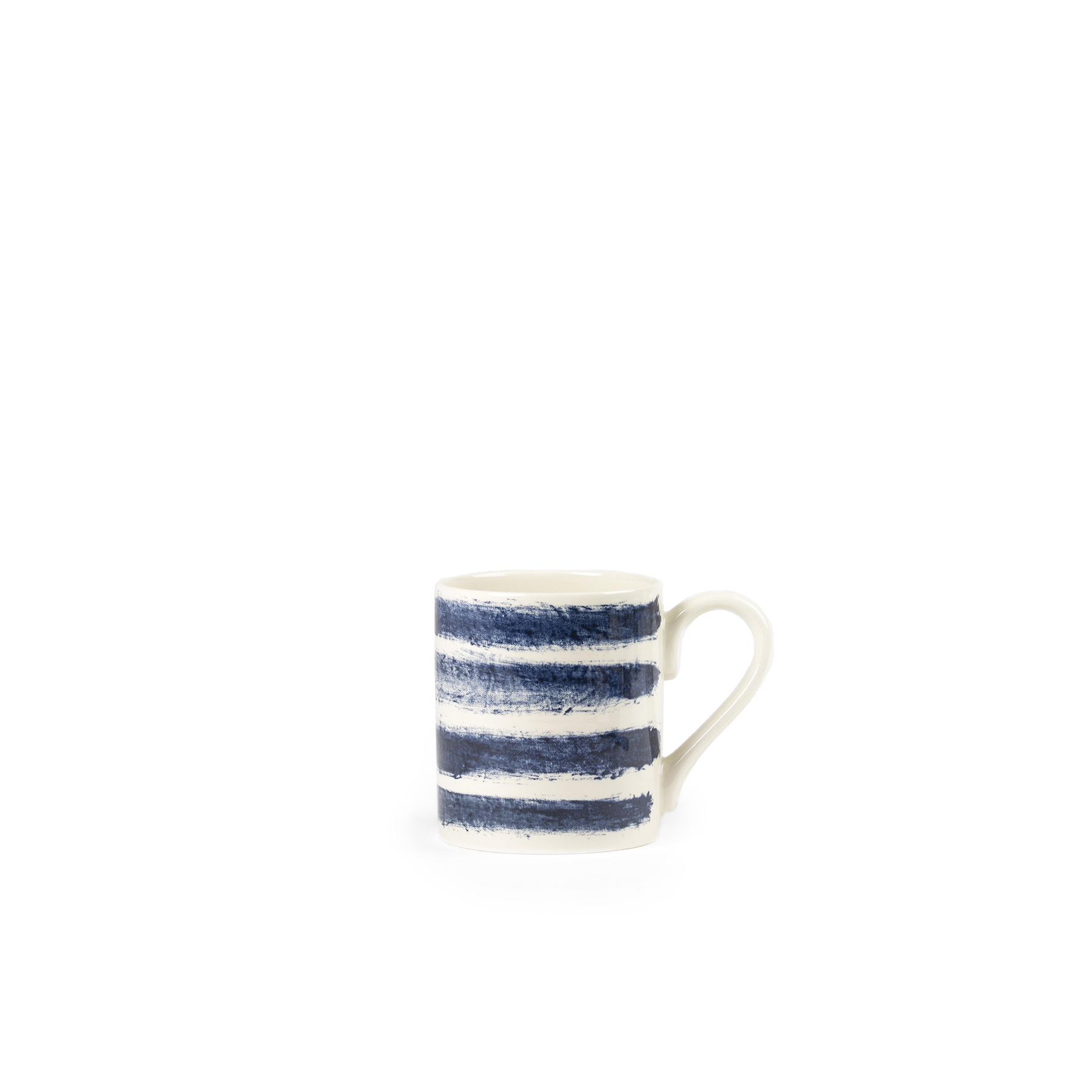 Indigo Rain Tankard - Faye Toogood's addition to her range of ceramic designs for 1882 Ltd. puts a fresh spin on the forms and traditions of English creamware. Indigo Rain reinterprets the homely familiarity of blue-and-white striped crockery in a new design informed by the spirit of serendipitous discovery. Representing a streamlined take on our ceramic heritage, the fine earthenware employs the familiar tones of English Delftware: cream offset with a rich, deep blue. Broad bands of indigo glaze, like painterly washes of watercolour, are applied to rough canvas and then transferred to the pieces – the characteristic grain of the fabric imbues the delicate ceramics with the hardworking spirit of dark-dyed denim.  | Matter of Stuff