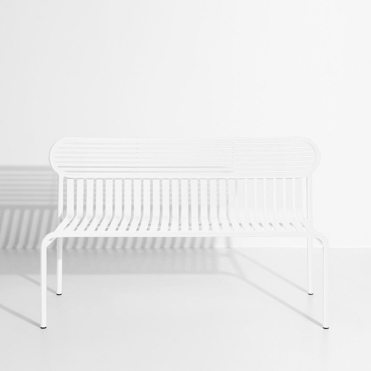 Week-End Bench - The WEEK-END collection is a full range of outdoor furniture. Designed with practicality in mind, all of the seats are stackable. The Week-End collection is a complete range of outdoor furniture. The oval and circular shape drawn by the backrests makes them a graphic statement. The impact of the horizontal and vertical slats, so similar to stripes, highlights the full and empty spaces, asserting the identity of the collection.  | Matter of Stuff