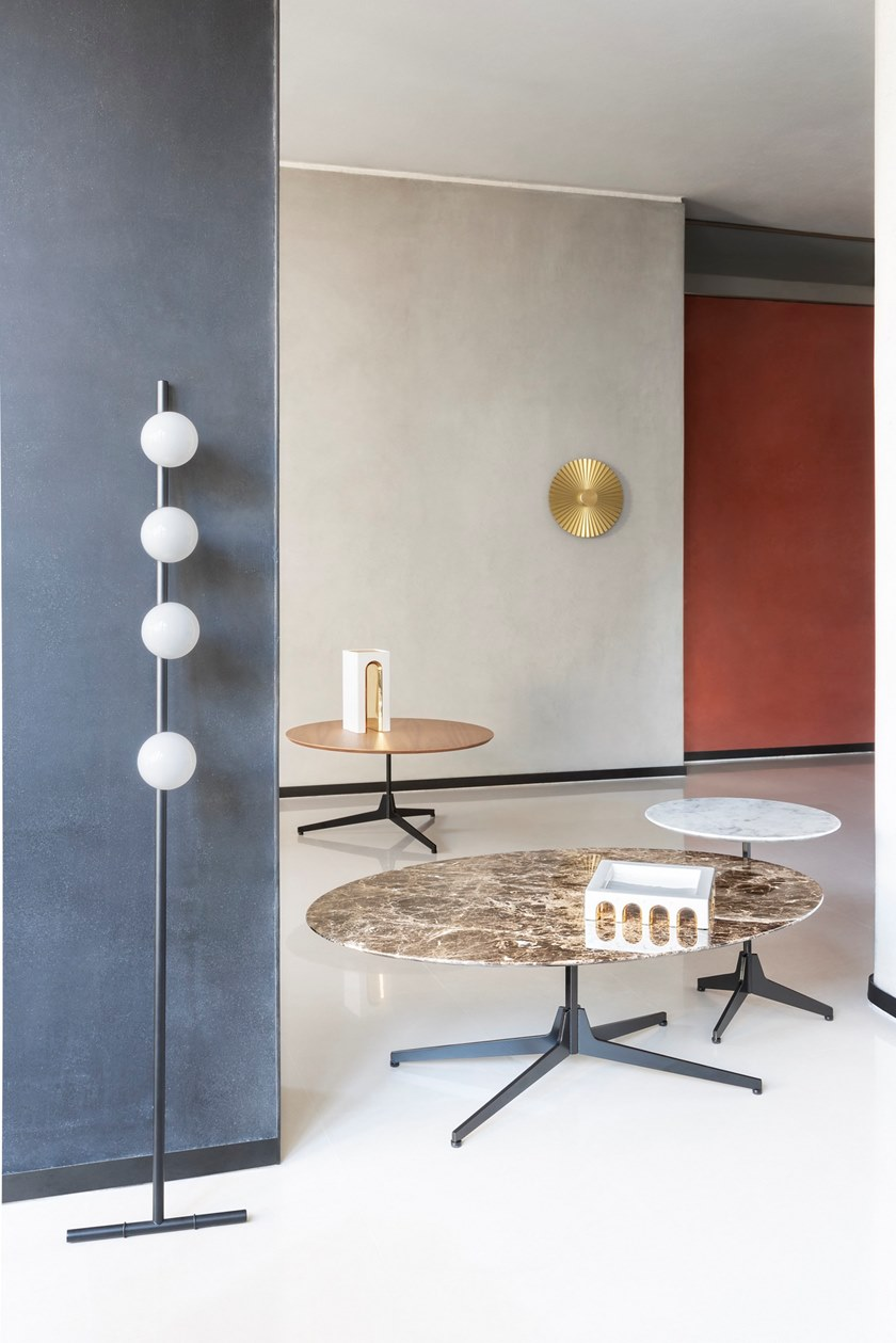 Hexa Oval Coffee Table - Hexa is an oval coffee table with marble top and 4-star base.  The project takes its inspiration from the concept of our memory, reimagining simple and iconic forms with echoes from the past. Central to the design is the upright hexagonal structure typically used in building construction that, in this particular context, is interpreted as a joint onto which the feet are attached perpendicularly. This style detail is reminiscent of 1950's furniture design. The base of the table is painted finished metallic wire drawn and the top in marble.  Materials Structure in painted wire drawn with hexagonal section and feet in steel blade. Thickness top in 10 mm and with tapered edge.   Matter of Stuff