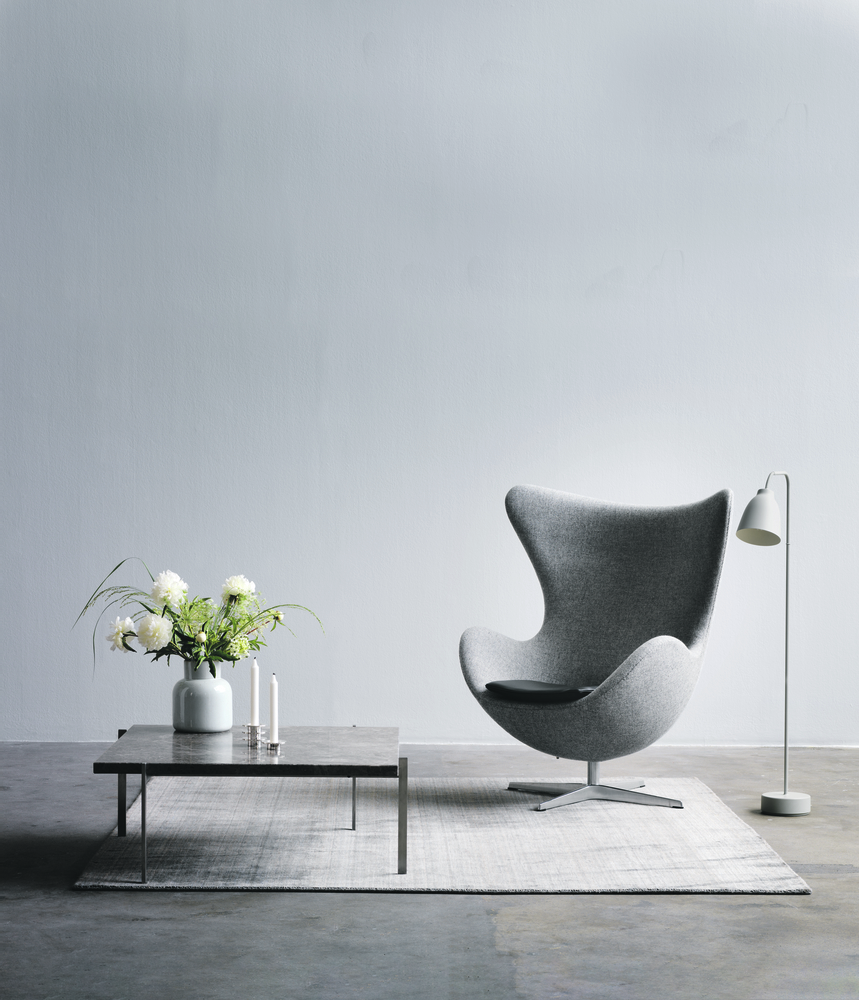 Egg Lounge Chair - <p>Experience originality and timeless design with the Egg in fabric and indulge in its sculptural curves that will last for generations. When Arne Jacobsen in the end of the 1950s designed the SAS Royal Hotel in Copenhagen, he too created the Egg, the Swan, the Swan Sofa, the Series 3300 and the Drop.<br /> With this furniture, Arne Jacobsen wrote history within Danish design worldwide. </p> <p>The Egg lounge chair comes fully upholstered in a wide range of fabric and leather types. The starbase is made of aluminium, mounted on a satin polished steel pedestal. </p> <p>The shell is made of synthetic material, padded with cold-cured foam. A matching footstool is available. A range of materials, colours and finishes are available in a number of combinations.<br /> Prices may vary. Please enquire for full details.</p>  | Matter of Stuff