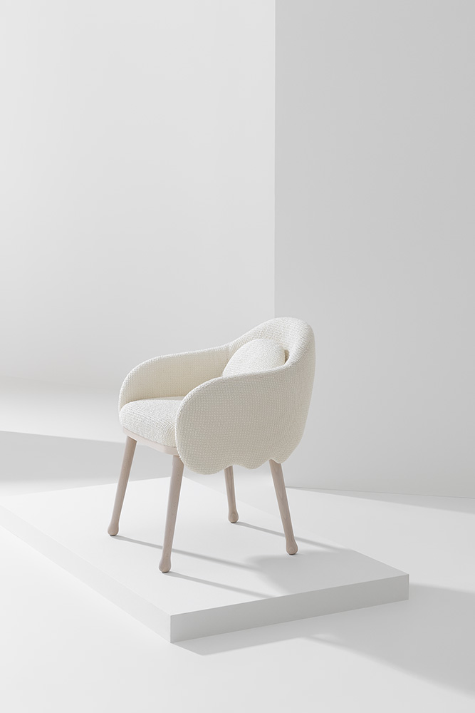 Corolla Armchair  - The Corolla Armchair is a sleek yet ergonomic armchair that fits into most spaces. From residential areas such as living rooms to communal commercial areas this armchair is versatile. The frame can come in Stained Ash, Stained Beech or Lacquered Beech and the chair comes upholstered in fabric, leather or your own material. It can come with an additional cushion. Please enquire for more information.    Matter of Stuff