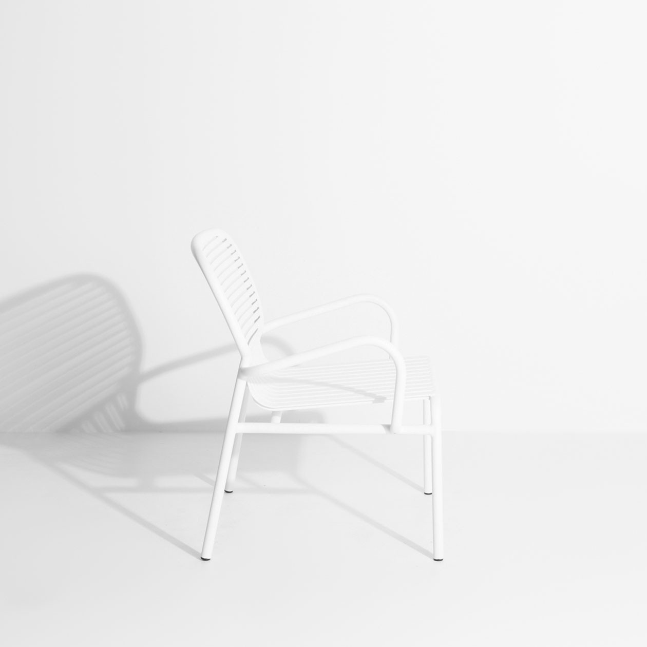 Week-End Armchair - The WEEK-END collection is a full range of outdoor furniture. Designed with practicality in mind, all of the seats are stackable. The Week-End collection is a complete range of outdoor furniture. The oval and circular shape drawn by the backrests makes them a graphic statement. The impact of the horizontal and vertical slats, so similar to stripes, highlights the full and empty spaces, asserting the identity of the collection. Quantity: 2 Chairs    Matter of Stuff
