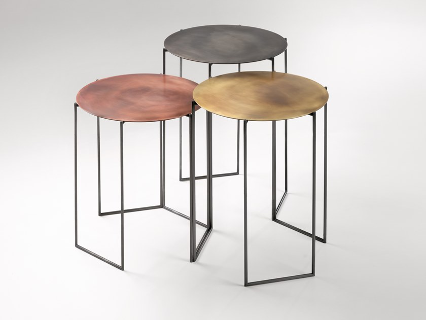 Band Side Table - The Band table set creates 'micro architecture' whose most distinctive trait is lightness.‎ Long, slender legs support thin circular table tops, where metal nuances vibrate.‎ In iron, brass and copper, these multifaceted objects gracefully and discreetly wear the sophisticated shades of De Castelli metals.‎ In different heights, they form a group of complementary, harmonious pieces destined to last over time.‎