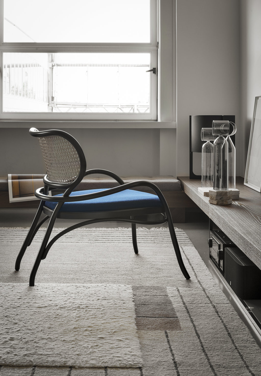 Lehnstuhl Lounge Chair with Upholstered Seat - This refined piece combines two staples of the brand furniture: the Viennese straw of backrest and seat and the steam-bent beechwood with a stunning black lacquered finish. Using these elements, Coates created a sinuous design that is welcoming and unique and will imbue a classic or contemporary decor with elegance.  | Matter of Stuff