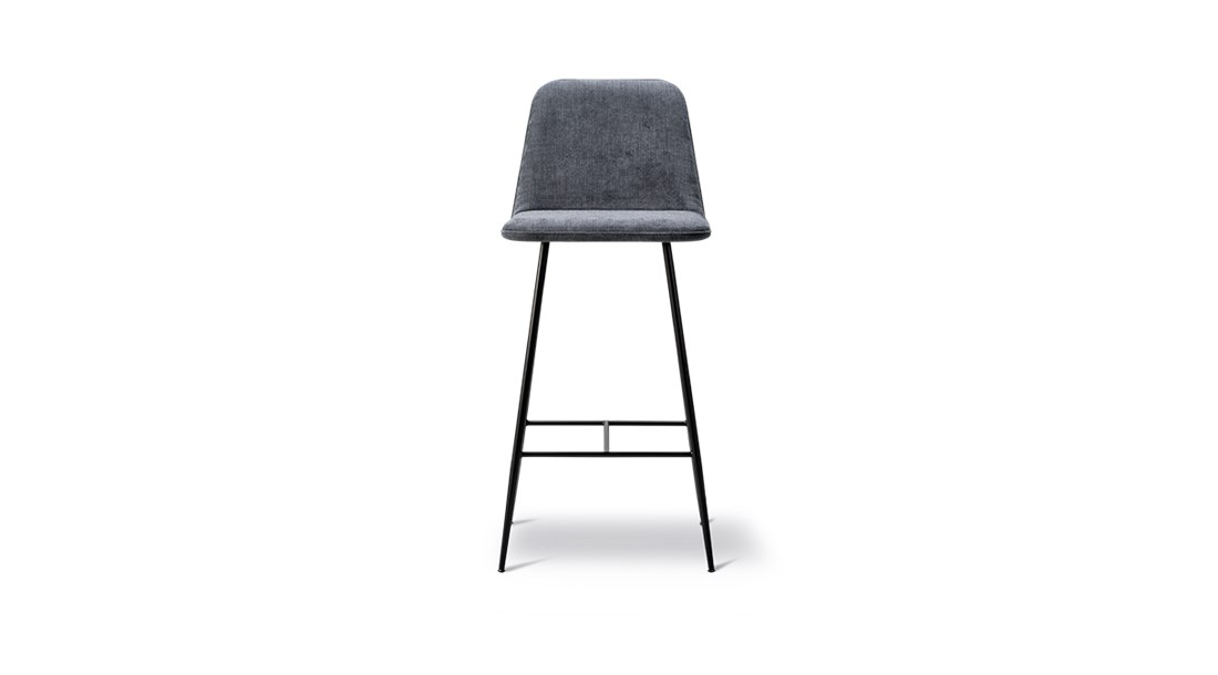 Spine Metal Base Barstool - A clean and modern visual language characterises the Spine collection, and this latest addition of a metal base strengthens the stunning expression of the family. The simple lines of the metal leg infuse the chair with a sleekness that contrasts perfectly with the plush, fully-upholstered seat, creating a beautifully balanced design. Spine signals a dynamic design language driven by strong lines balanced by subtle curves. Contrasts that merge into a singular, balanced entity. Solid and graphic yet soft and organic.   The design is anchored in Nordic tradition but with a sophisticated, modern twist that gives it a striking, fresh aesthetic.   The Spine series has expanded since its initial launch to encompass a variety of products and a growing number of variants, found in deluxe restaurants, bars, hotels and exclusive retail shops worldwide.   Adding a touch of tension and dimension is the interplay between the upholstery and the base, available in either wood or metal. Spine in wood is classic and luxurious, exuding a certain strength of character. Whereas the sleekness of the metal base signals a look that's more modern and light. The upholstery is inspired by techniques that were developed at our Fredericia workshop for Børge Mogensen's exclusive 1960's leather series.   With its graceful appearance, Spine is all about contrasting elements that culminate in a cohesive concept that's inviting wherever you place it. | Matter of Stuff