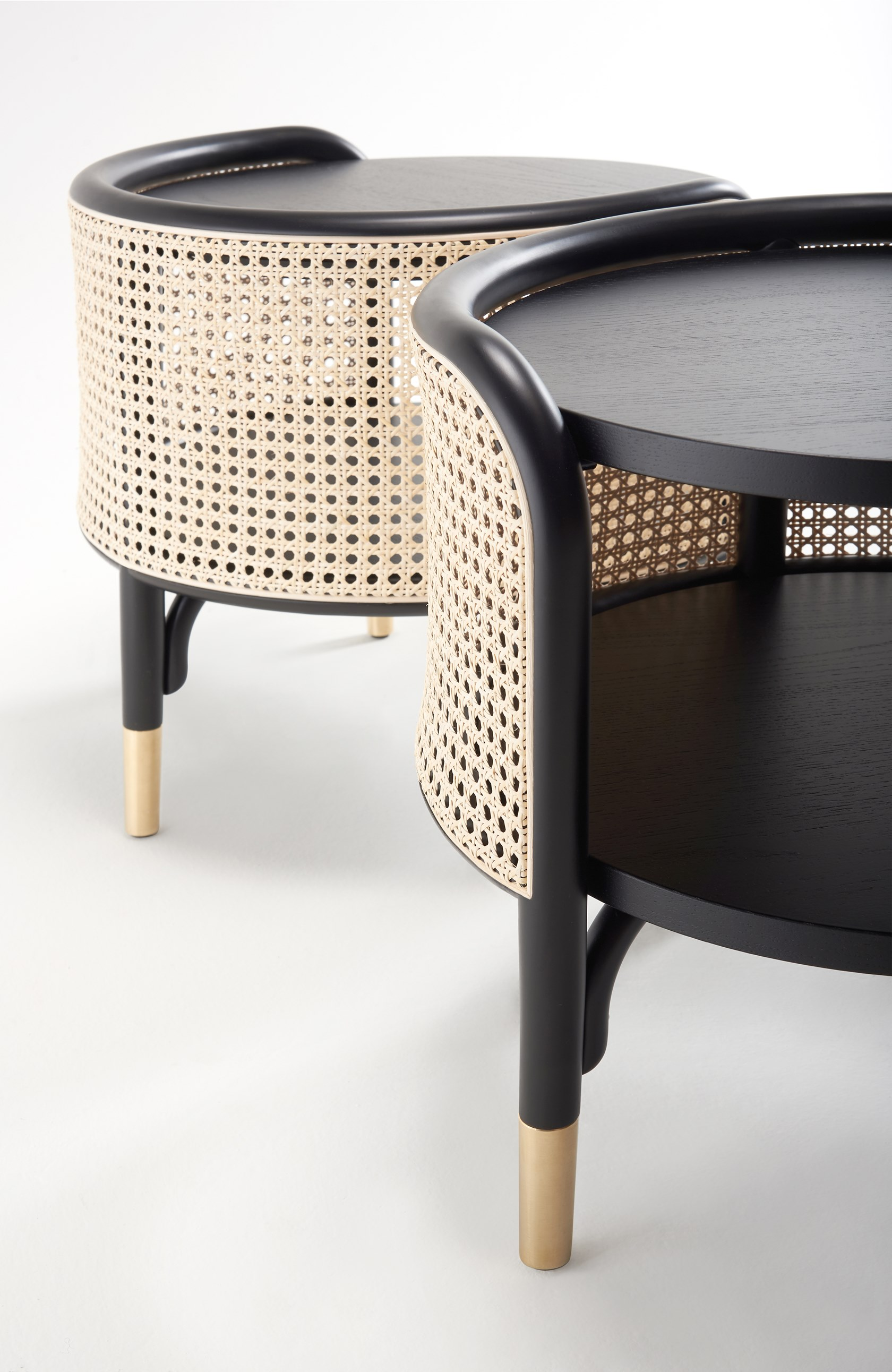 Mos Side Table - Mos is a side table with bent beech-wood frame and woven cane inserts. Open pore painted shelves in ash veneer. Brass feet.  MOS is the family of storage units designed by GamFratesi with console, bookcase and side table, which can also be used as a bedside table, that incorporates the style of the bench of the same name, another GamFratesi project. Ellipse shape and calibrated dimensions remain common features of the new elements, which fit into any environment, thanks to their light elegance, whether it be the living room or the sleeping area as in refined lounge spaces. The woven cane shell conceals the wooden tops, two for the coffee table, three for the console and four for the bookcase. The frame in natural stained or black lacquered bent beech wood is supported by brass feet. | Matter of Stuff