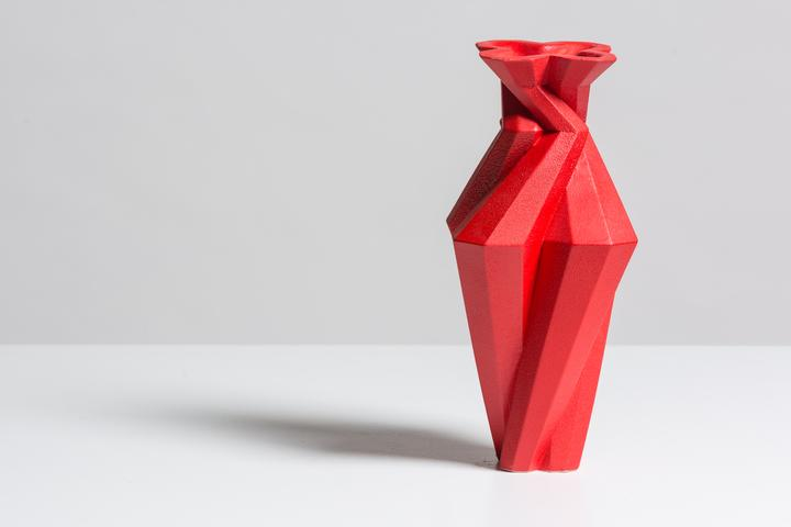 Fortress Spire Red - <p>Designer Lara Bohinc explores the marriage of ancient and futuristic form in the new Fortress Vase range, which has created a more complex geometric and modern structure from the original inspiration of the octagonal towers at the Diocletian Palace in Croatia. The resulting hexagonal blocks interlock and embrace to allow the play of light and shade on the many surfaces and angles. There are four Fortress shapes: the larger Column and Castle (45cm height), the Pillar (30cm height) and the Tower vase (37cm height). These are hand made from ceramic in a small Italian artisanal workshop and come in three finishes: dark gold, bronze and speckled white.</p>  | Matter of Stuff