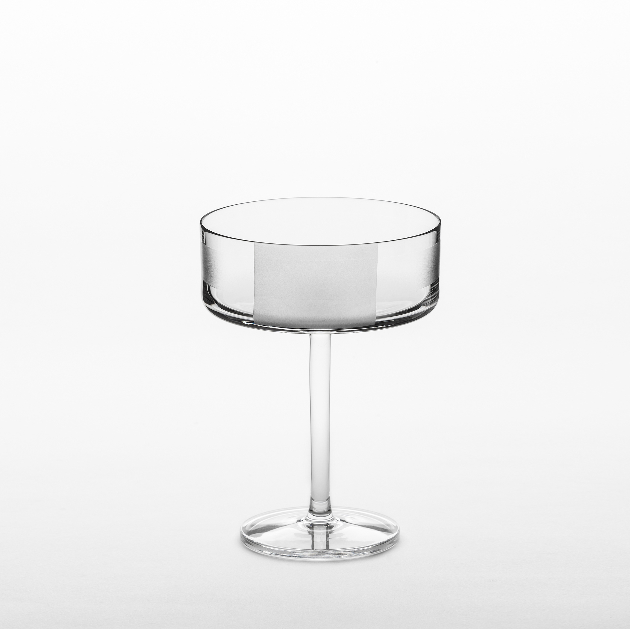 "Element Cocktail Glasses - Set of 2 - A rich assemblage of graphic markings defines the ""ELEMENTS"" series of lead crystal. Cuts and textures of varying depth and intensity are employed across glasses to create a landscape of layered pattern that is fresh and seductive; a whole new take on the decoration of cut crystal.