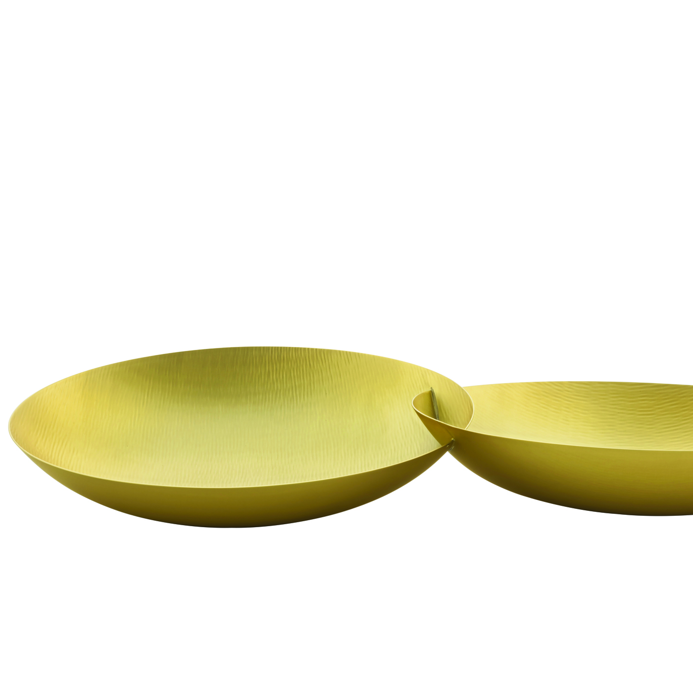 Dellabbondanza Bowl - This exquisite double bowl was made in brass with a satin finish. The elongated oval shape of its two elements that have been joined together is elegant and timeless and symbolically represents the unity of two entities. The internal textures are entirely hand-hammered giving the appearance of tiny ripples forming on the surface and adding dynamism to this sophisticated object that can be a centerpiece or a versatile tray to use in an entryway. | Matter of Stuff