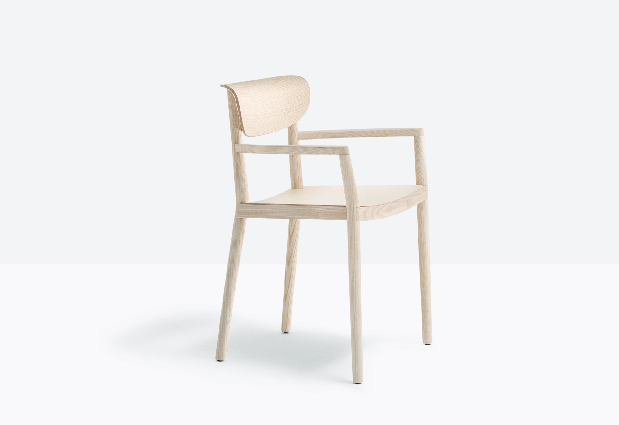 Tivoli Wooden Armchair - Tivoli recalls the traditional wooden chairs, maintaining comfort and inspiring conviviality. Solid ash wood armchairs with three-dimensional plywood back. | Matter of Stuff