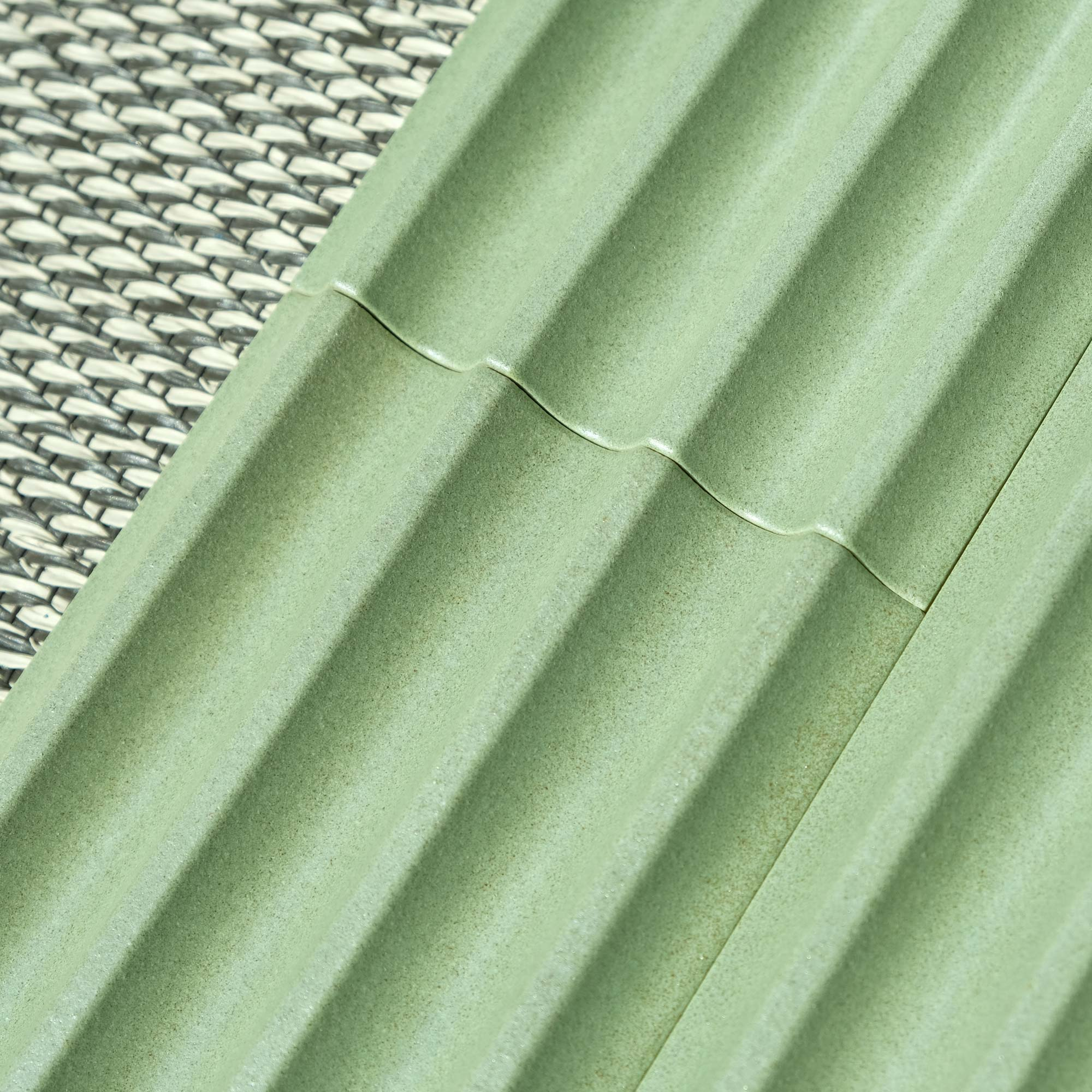 Fluted Ceramic Tile Green Matt - Matter of Stuff Fluted ceramic tiles are characterised by a smooth rippled surface.  Perfect to design Interior walls and bar front with sinuous flutes, multi-faceted patterns and elegant reliefs.  The tiles sized cm 10.5×21.5 x h max 1.5 cm and add a sense of movement through the introduction of their 3D surfaces profile, playing with shadow, light and tactility.  Fluted Tiles are produced in accordance with a hand-crafted technique which makes the material heterogeneous, both in the effects on the surface and in the dimension of the pieces.  Custom glazing colours and effect are available.  Get in touch to produce a bespoke fluted profile at bespoke@matterofstuff.com   Matter of Stuff