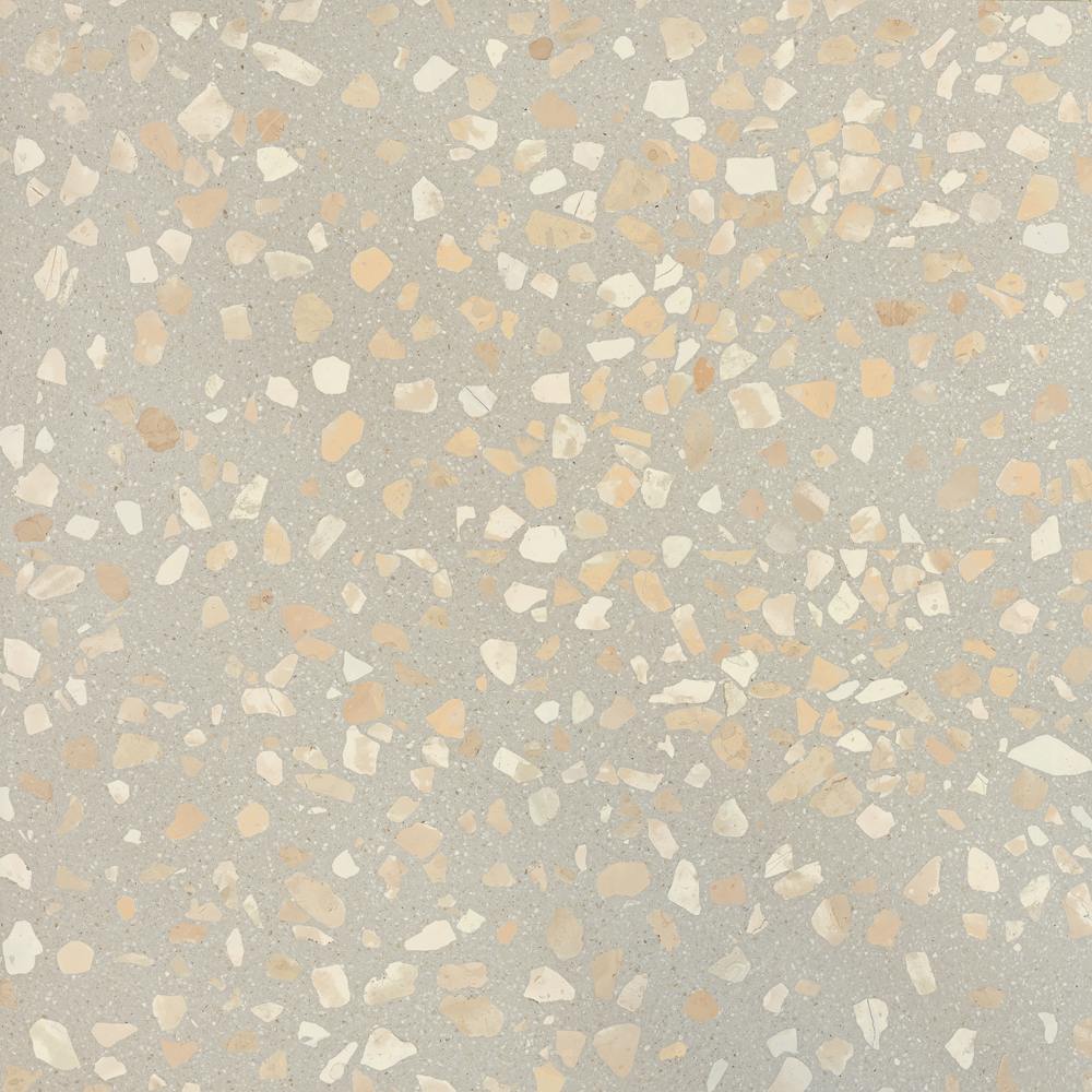 """Wild Rose Terrazzo Seeds - The name of the SEEDS collection, """"semi"""" in Italian, is intended to pay homage to the tradition of Seminato, an ancient Italian technique from which contemporary Terrazzo originated. As the word itself suggests, the technique consisted in spreading the marble fragments on the still fresh mortar. The gesture made in the act of sowing has an ancestral meaning in itself: we owe our evolution to nature, which has taught us this.  The poetic image of the traveling seed, at the mercy of the wind and the sea, landing on beaches in unknown lands ready to germinate to give birth to a new plant, is the great metaphor that MIPA wants to use to communicate the urgency and the need to imagine a future made of care, recovery of emotions and enhancement of simple gestures.  SEEDS is a call to the origins.  The colour that distinguishes the entire collection is that of sand. A single background colour, warm, on which the marble fragments rest in the eight colours that make up the palette with a sophisticated aesthetic result.  The new SEEDS collection was born thanks to the collaboration with Laura Renna, a visual artist MIPA has a longstanding relationship with, hosting her studio inside the company. In her artistic research, Laura is used to face themes such as tradition, nature and space.  The materials in the collection are available in different standard sizes. Bespoke sizes are also available to meet the specific requirements of your projects. 