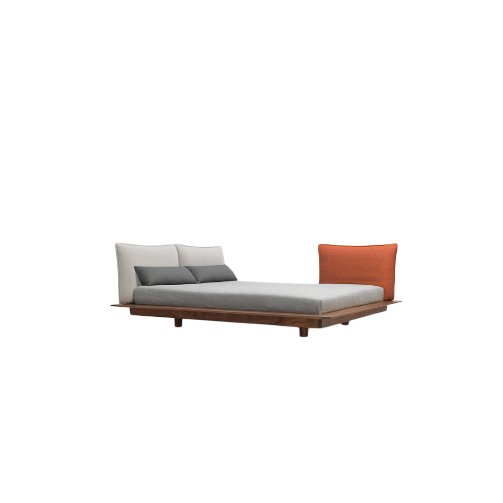 Yoma Bed  - YOMA appears to be floating. The bed stands apart through its low frame. The long side of the bed serves as a shelf, one detail of the craftsmanship is the wave that serves as a wooden connection. Through its rounded corners, the bed also appears soft and inviting. The mattress only sinks down a few centimetres; it appears to be lying on top.  The back cushions can be fixed in different positions. Feel right at home: YOMA can be arranged according to your mood and offers many options to make yourself comfortable while sleeping, reading and resting. The freely positioned side table YOMA Plate is equally uncomplicated and sets a graphical accent.  YOMA bed is available in white oiled ash, oiled oak, colour stained oak, oiled American cherry, oiled American walnut and oiled European walnut with integrated ZEITRAUM slatted base system, side support profiles 3 × 2.5 cm and central support profile 2.5 × 5.5 cm.   Mattress size comes in L200 x W100, L200 x W120 cm - Twin | L200 x W140 cm - Full | L200 x W160, L200 x W180 cm - Queen | L200 x W200 cm - King, California. Available in special sizes at an additional charge upon request.  The upholstered headboard is available in three types/sizes, Upholstered headboard L, S and Side upholstery.   Upholstered headboard L: L126, 146, 166, 186, 206, 226 x W16 x H60 cm (Can only be fixed at the headboard and the footboard) | Upholstered headboard S: L82.5, 92.5, 102.5, 112.5 x W16 x H60 cm  (Can only be fixed at the headboard and the footboard) | Side upholstery: L 92.5 x W16 x H60 cm (Can only be fixed to both sides of the bed)  For colour stained oak and upholstery options, please refer to the catalogue.   | Matter of Stuff