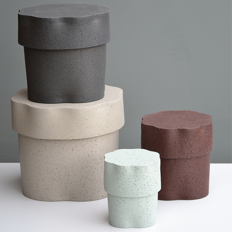 Jig Containers  - <p>A set of four nested containers made out of laminated cork, which we manufacture ourselves. We also add colour, resulting a very attractive textured material.<br />
