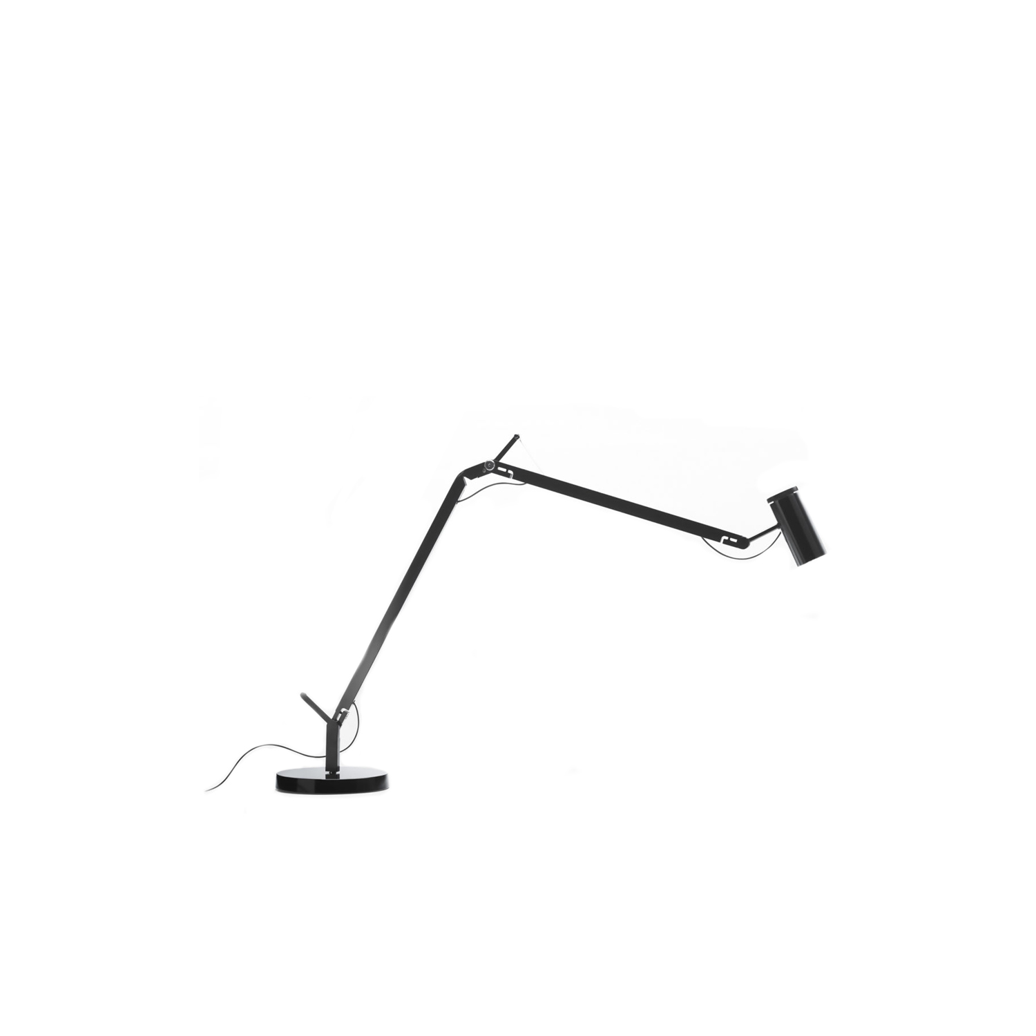 Polo Table Lamp - The fluidity of its movements and its total stability make this flexible fitting a light source which can be moved anywhere without cluttering your desk or taking up too much valuable space. Its integrated LED technology allows one to direct the beam with the utmost precision, for a light that is both focused and warm, yet highly useful.  The Polo comes with a diffuser made from injected aluminium, arms and built-in swivel joints CNC milled from an aluminium block, and a rotary switch located in the upper part of the head stock.  Available in black, the Polo can be equipped with a range of accessories, including a table base, a wall bracket, and a standing version | Matter of Stuff