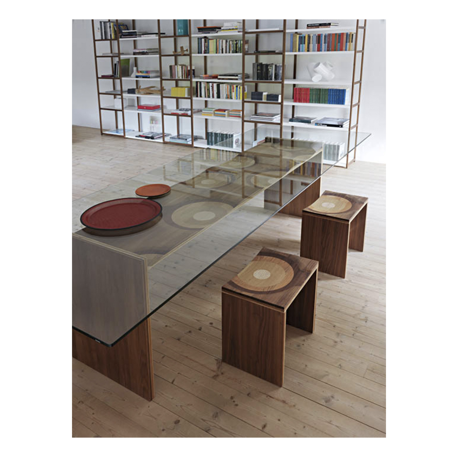 Ripples Dining Table - <p>The Ripples bench by Toyo Ito, winner of the 2004 Compasso d'Oro, has blossomed into a collection of different furniture types. Amongst them, we may highlight the Ripples table, featuring a transparent glass table top that presents its impressive structure, fabricated with a laminated composite of five different solid woods namely, walnut, mahogany, cherry, oak and ash. The fibre colours and directions are purposefully defined to produce an elegant polychromatic effect. The top is in tempered glass, thickness 12 mm. This unique and poetic woodwork, created within a strict aesthetic framework, is reminiscent of fluid motion, not unlike the ripple-effect produced by a stone tossed in the water.</p>  | Matter of Stuff