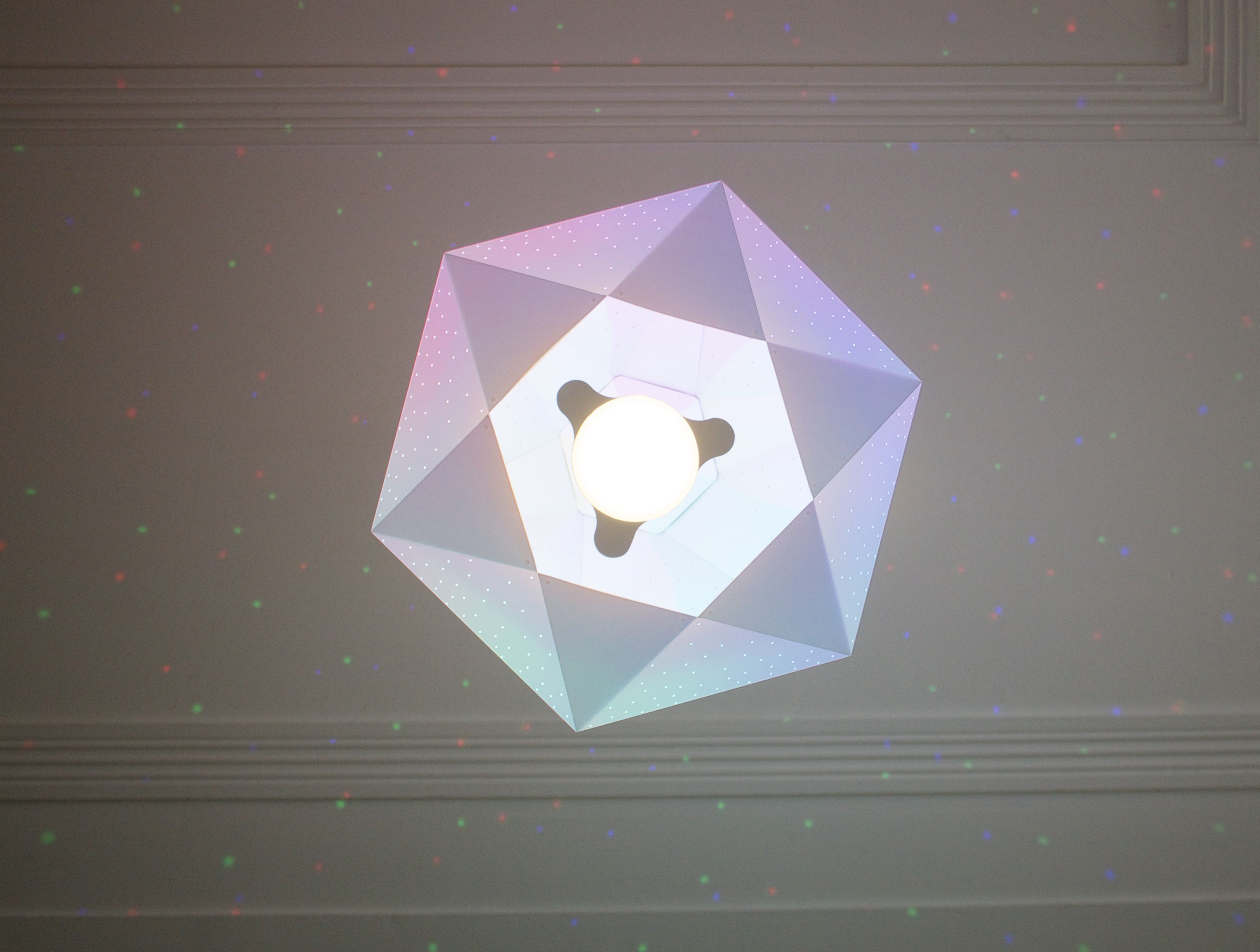CMYK Diamond - The faceted Diamond shade is made of matte white polypropylene covered in tiny pin-pricks to scatter coluored dots of light onto surrounding surfaces. The light sparkles through the little holes like a real diamond.
