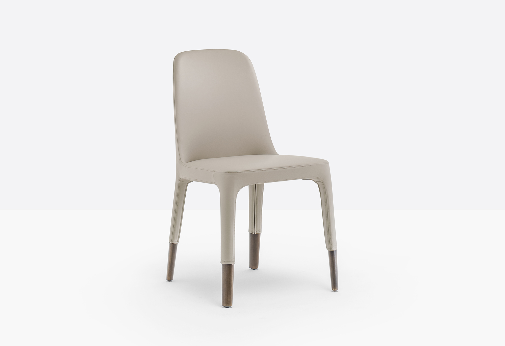 Ester Chair - Ester is a mix of elegance, ergonomics and functionality. The soft and graceful lines and the great comfort offered by the seat distinguish the interior of the most exclusive restaurants and hotels in the international scenario. Chair with upholstered shell in polyurethane foam with elastic belts and die-cast aluminium legs.   Matter of Stuff