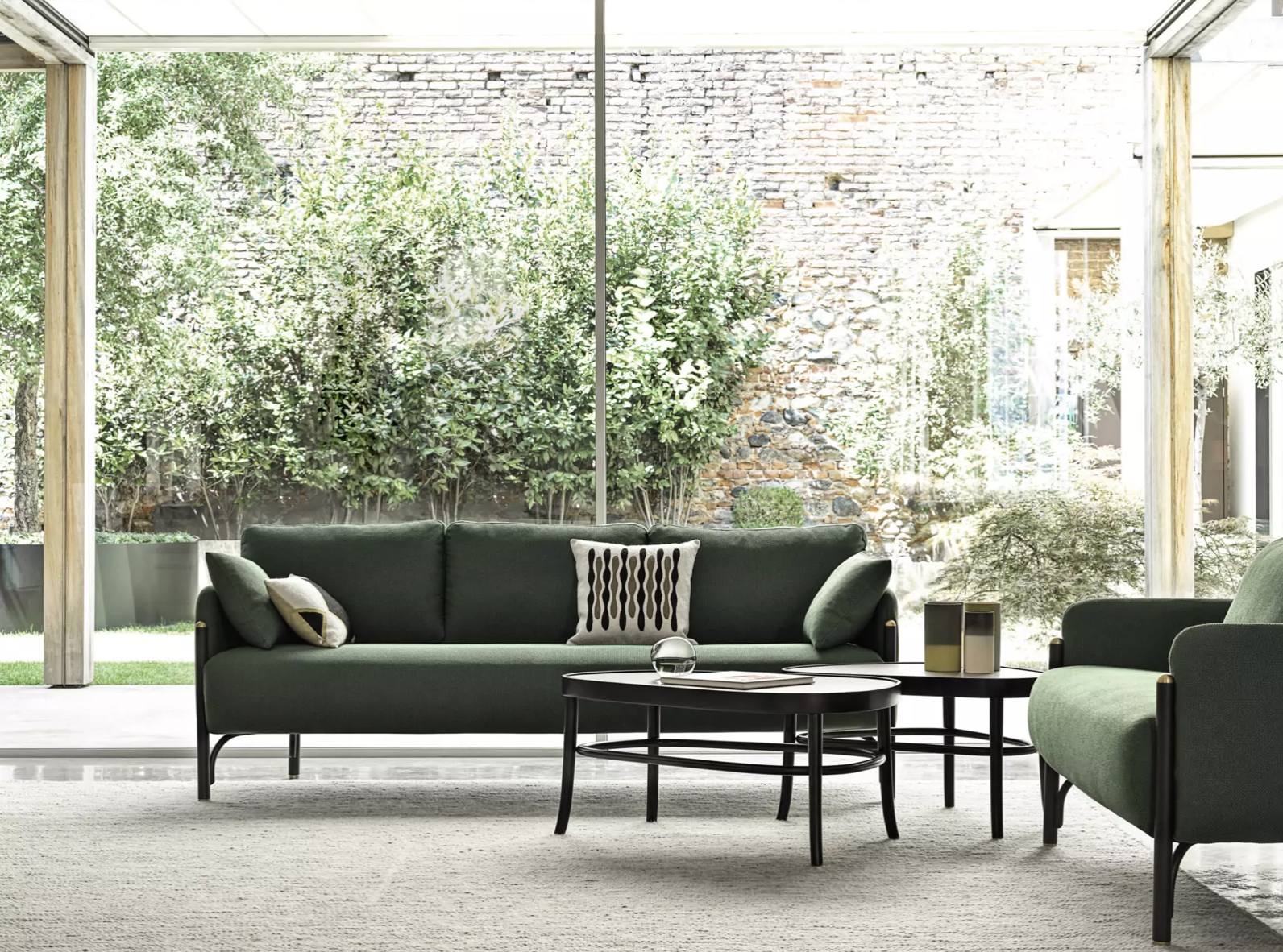 Peers Coffee Table - The Swedish duo Front designs the new PEERS coffee tables. High-end project that marks a new encounter with Gebrüder Thonet Vienna for which the two designers have signed some of the bestsellers of the contemporary collection such as the Hideout lounge chair, the N.0 chair and the Coat Rack Bench. The PEERS collection includes two tables, elements designed in pairs but also perfect used individually, ideal in the living area or in the bedroom as bedside tables. With a characteristic contoured shape, they have a colored laminate top with solid wood edge while the structure is enriched by the wooden ring, a structural element that incorporates the typical support circles of the classic bent wood chairs. The heritage of Gebrüder Thonet Vienna inspired Front also in the design of the legs which contributes to defining the lightness of PEERS without affecting its stability. | Matter of Stuff