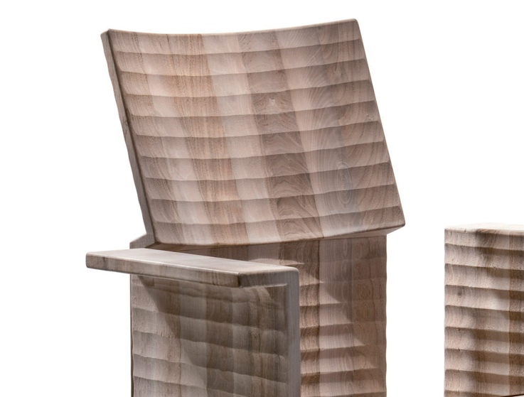 Gaudenzio Armchair - <p>Gaudenzio is an armchair made from hand-carved planks. It is finished manually on all sides by gouging.<br />