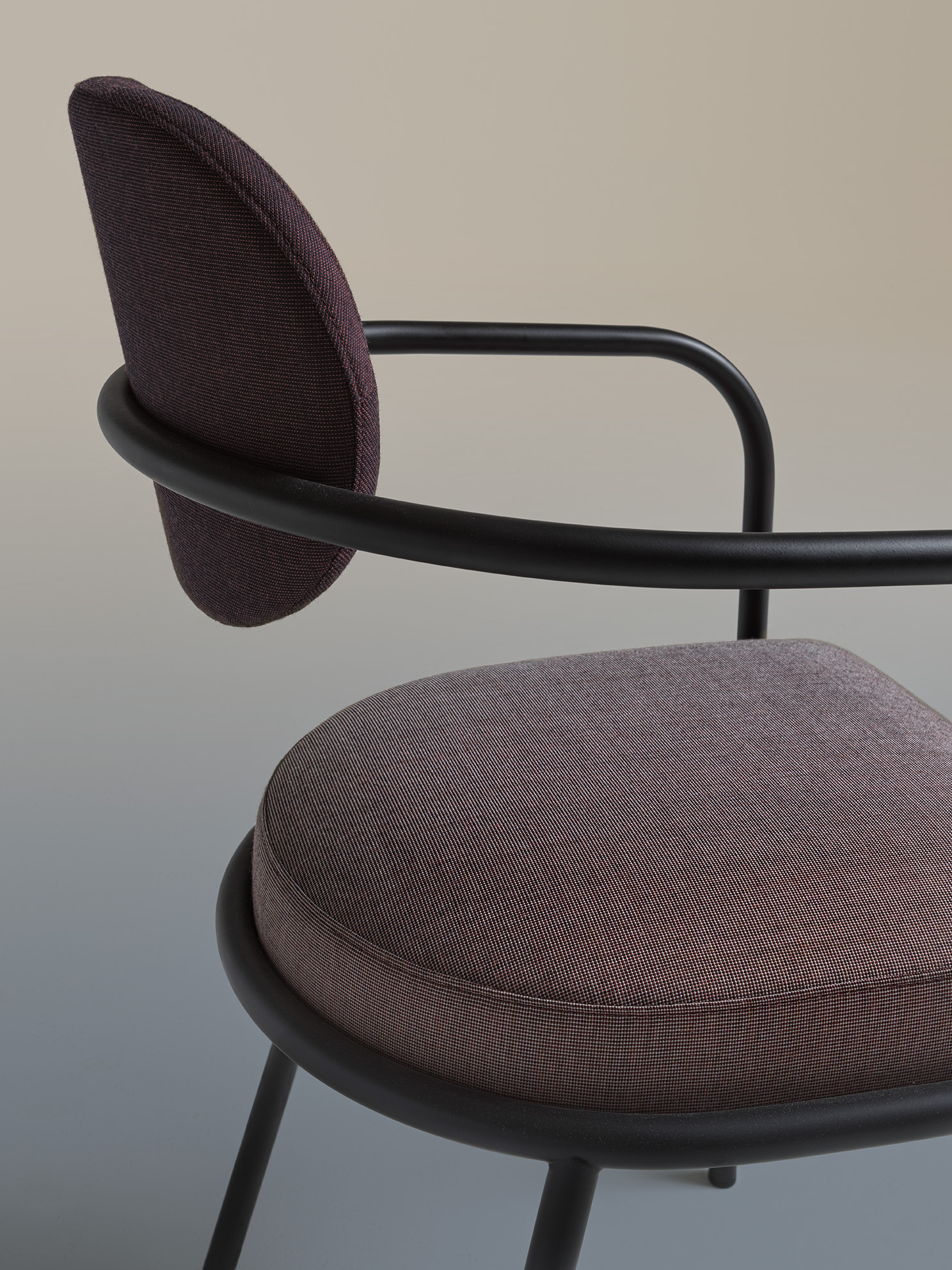 Ula Armchair - <p>Distinguished by its curved tubular frame and fabric upholstery, Ula stands out for its slim, rounded body which alternates with the welcoming shapes of the padded seat and backrest. Ula is a chair with light volumes and precise shapes. The seat armrest bends down towards the floor, to such an extent that it becomes its front leg, giving the chair itself a truly light-weight appearance, making it look almost suspended.</p> <p>Ula Chair is made of a tubular steel frame. Seat and back are in polyurethane foam and polyester fiber lining. Cover in mono or two coloured fabric.</p> <p>A range of materials, colours and sizes are available in a number of combinations. Prices may vary.<br /> Please enquire for full details.</p>  | Matter of Stuff