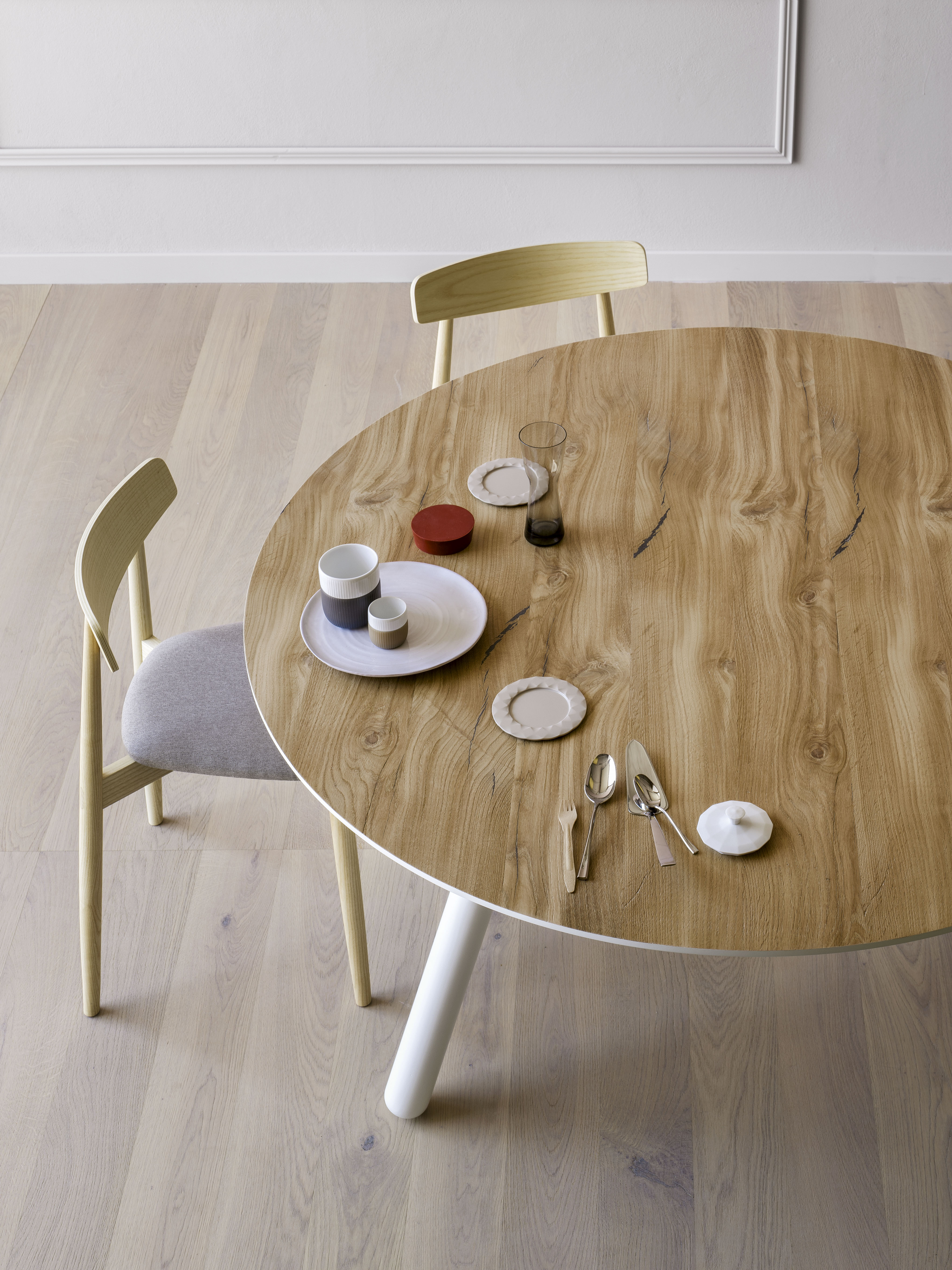 Pixie Round Wooden Table - Pixie is available with oval, round, or rectangular top lacquered white, black or inflamed oak, black ash, vintage oak, heat-treated oak and Canaletto walnut veneer. The legs are lacquered in the same finish of the top or realised in natural ash, grey aniline or black aniline. A range of materials including ceramic and marble, colours and sizes are available in a number of combinations.   Prices may vary. Please enquire for full details. | Matter of Stuff