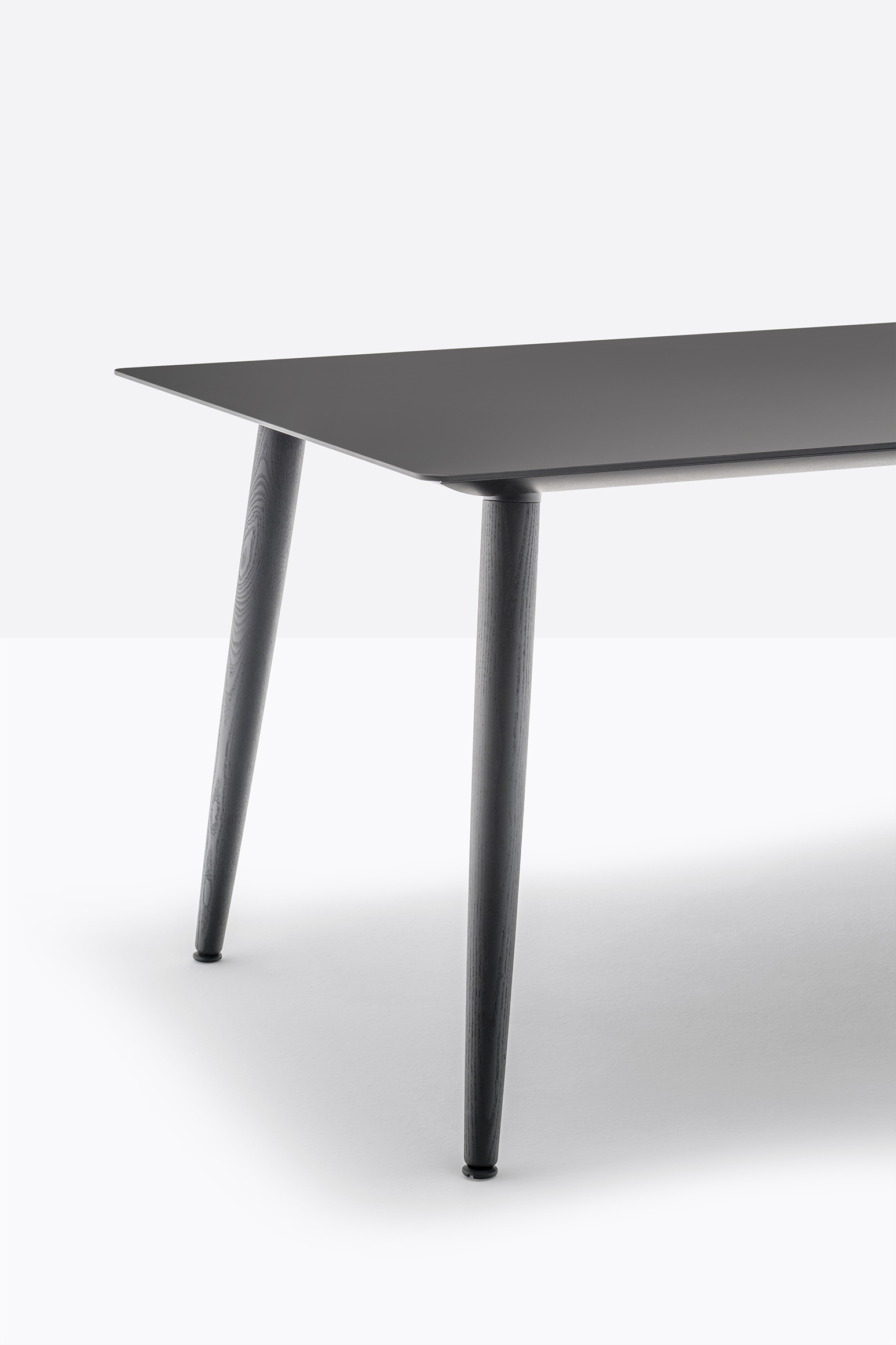 Babila Table - <p>Babila table reveals the rigorous lines and the natural warmth of the solid ash wood legs matched with an ultra-thin solid laminate top, supported by an extruded aluminium frame.</p>