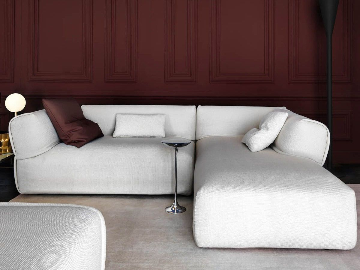 Rever Modular Sofa - Rever features plump, generous curves and proportions. The original way the armrests are fitted - a fundamental feature of this sofa – is paired with special attention to detail: the slightly padded edge looks as if it comes from a fashion house because it is inspired by the lapel of jackets and the flap of pockets. Rever is an extremely versatile sofa. The large day beds and the comfortable poufs make it perfect for moments of enjoyable togetherness and play. | Matter of Stuff