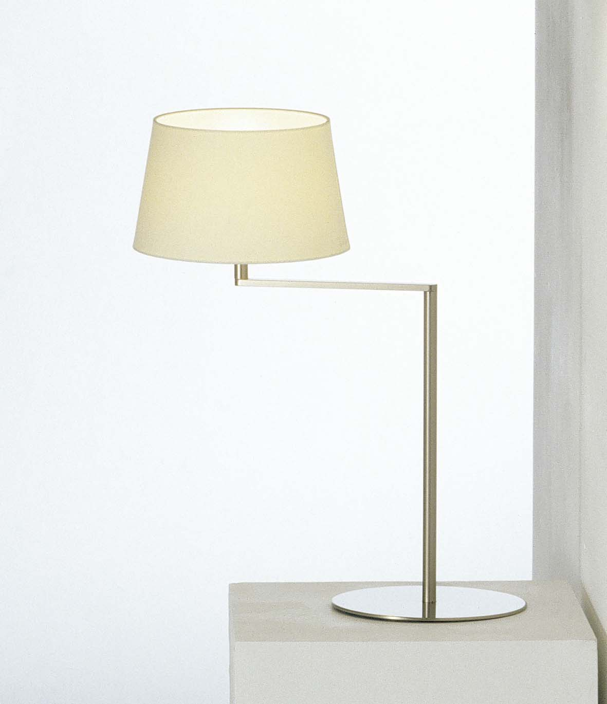 Americana Table Lamp - <p>Enthralled by the idea of enhancing Hansen's remarkable geometry, Milá's Americana series is also based on a swing arm, although here the arm is a single section with a right-angled bend. Accordingly, the head of the shaft becomes the swivel that enables the shades horizontal rotation, reducing the lever effect. The arm can be moved towards you or away from you without shifting the large metal base, evoking the swing motion.</p>  | Matter of Stuff