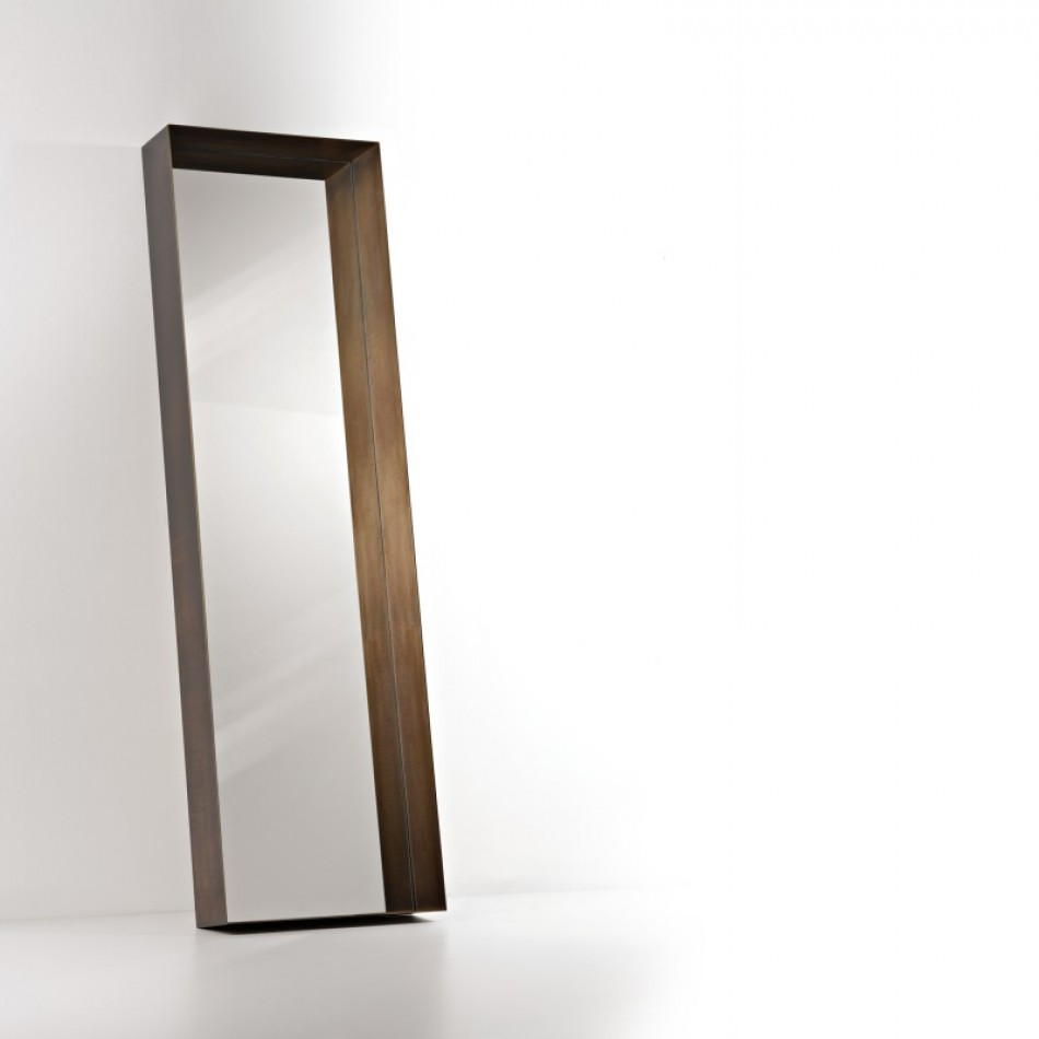 Frame Freestanding Mirror - Frame is a mirror wrapped in a deep metal bezel. Drawing close is unavoidable for those who look in the mirror, enabling them to observe their image from closer up. Ever the provocateur, Frame doesn't allow us to settle for the surface, advising, in some way, introspection and awareness. Almost as if to convey the impermanence of the image reflected, this object is meant to be affixed to the wall in an inclined position. | Matter of Stuff