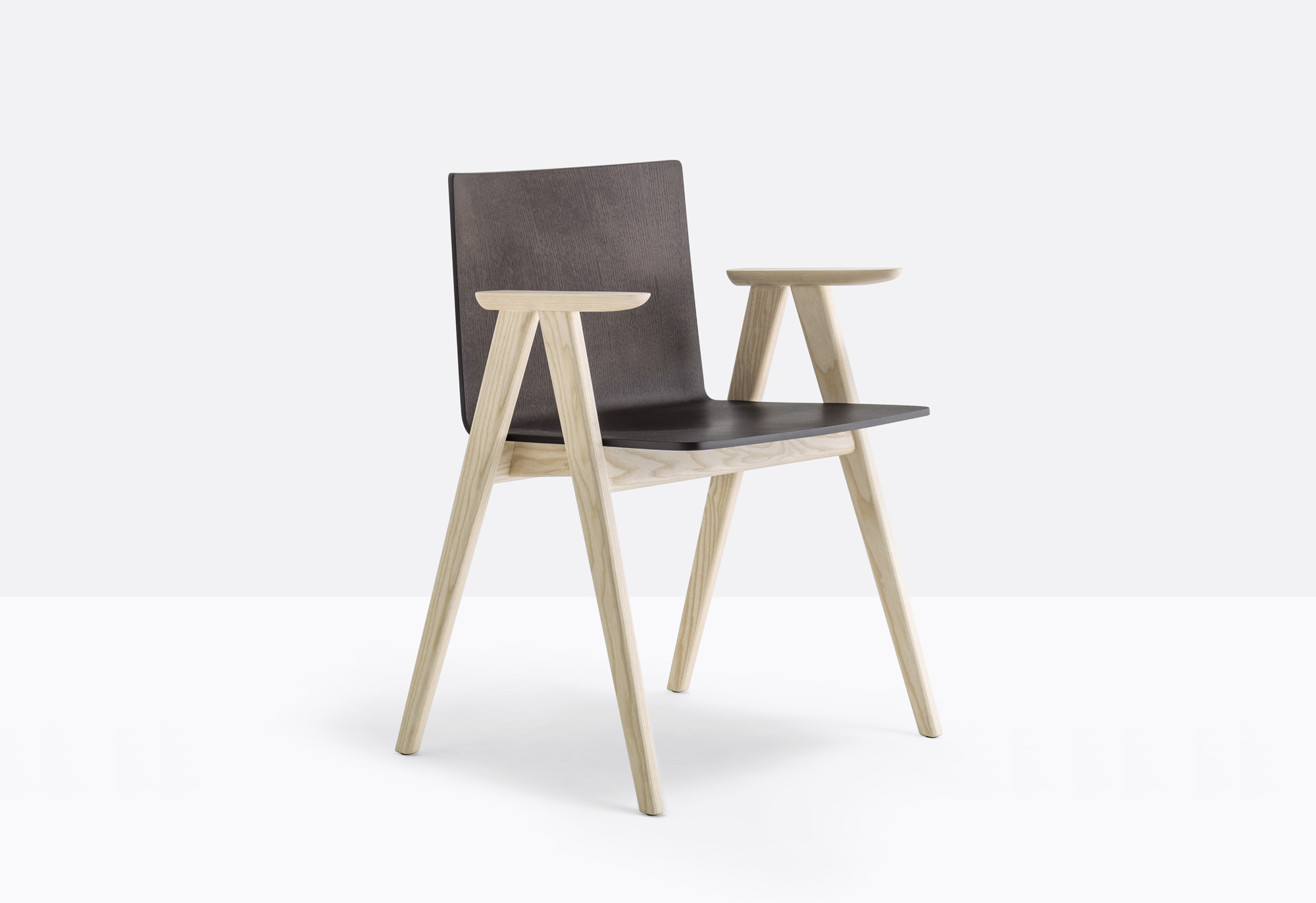Osaka Armchair - Osaka is a collection of seatings with a strong graphic impact whose construction elements remind the linear features of an ideogram. Armchair with ash veneered plywood shell, solid ash wood frame and armrests | Matter of Stuff