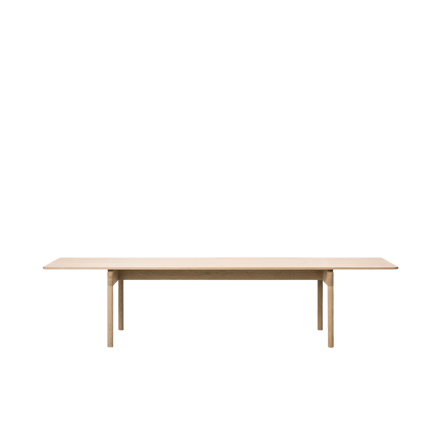 Post 6442 Dining Table - With its long rectangular table top and sturdy cylindrical legs, the Post Table is the perfect merging of functionality, simplicity and serenity in a classic design expressed with modern minimalism. The structural frame is exceptionally crafted in solid wood, teamed with a table top in solid oak. Enjoy loads of leg room in the wide space between the legs on either end, adding to the appeal of this practical, tactile table for dining or meeting in a residential, corporate or hospitality setting.