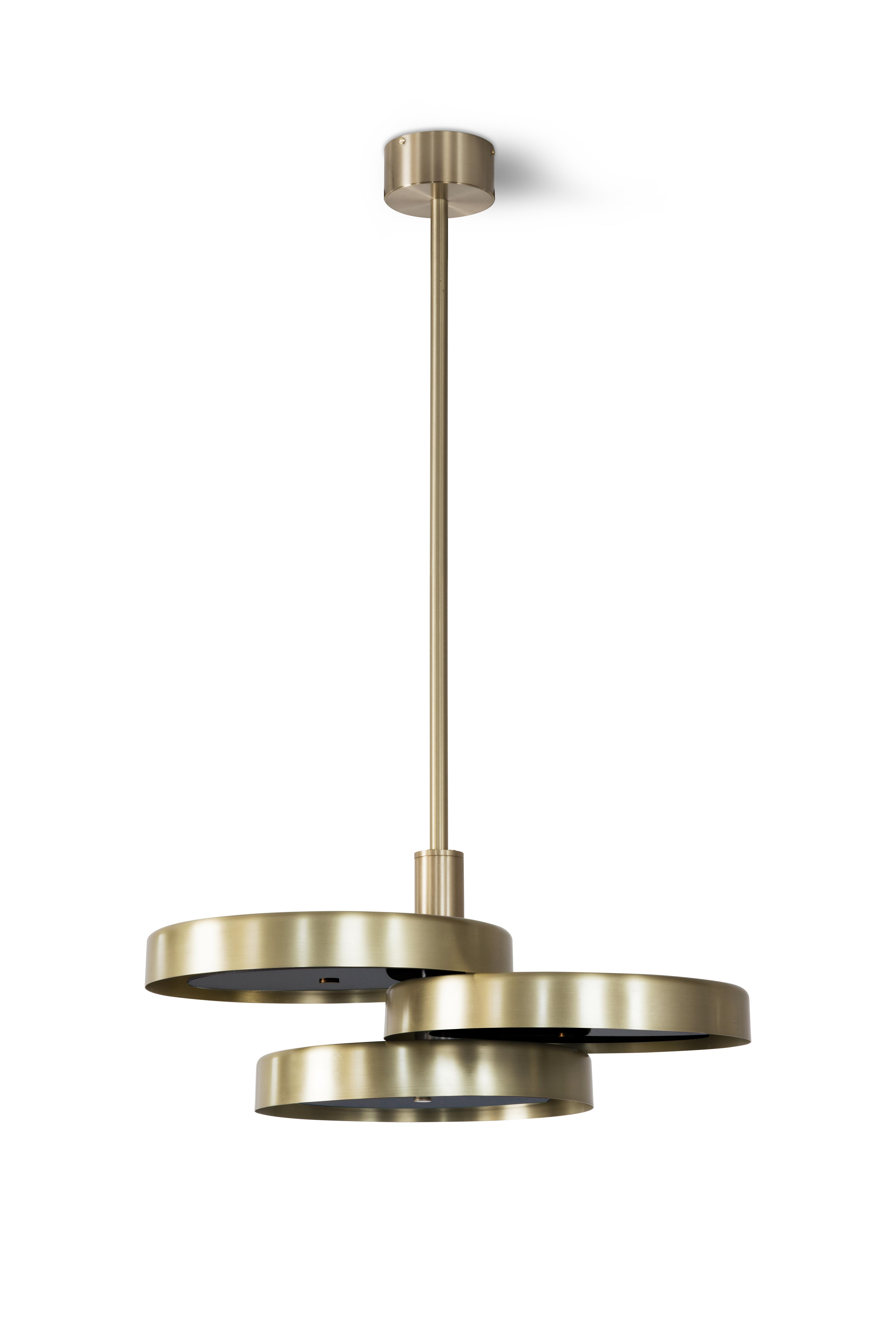 Triarc Pendant Light - <p><span>With three intersecting brass discs hung from a single drop rod, the Triarc Chandelier makes a dramatic impression. Grouped together with two or more pendants it creates a sculptural focal point. Available with opal or black diffusers. </p> <p></span></p>    Matter of Stuff