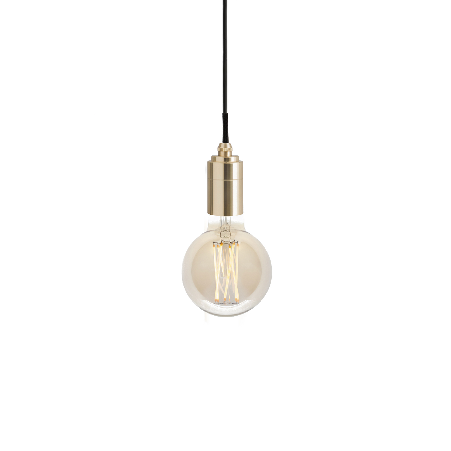 Elva Pendant Light - The Elva Pendant Light combines the compact, exposed-filament Elva bulb with a single hanging pendant to create a ready-made light fixture for any interior space.  Available in tinted or non-tinted glass, the Elva Pendant Light is perfect for hanging in the centre of a room or hallway, above an island or as a decorative feature. The phosphor-coated filaments and iron-tinted glass create a warm, amber glow to add atmosphere, while the clear glass version offers a brighter light output for functional spaces.  Available with the Brass, Graphite, Oak or Walnut pendant.  Features – Dimmable – Stylish lighting fixture – Energy-efficient, LED technology – Exposed filament bulb design – Available with a Brass, Graphite, Oak or Walnut pendant – 3 metre length cord for versatility | Matter of Stuff