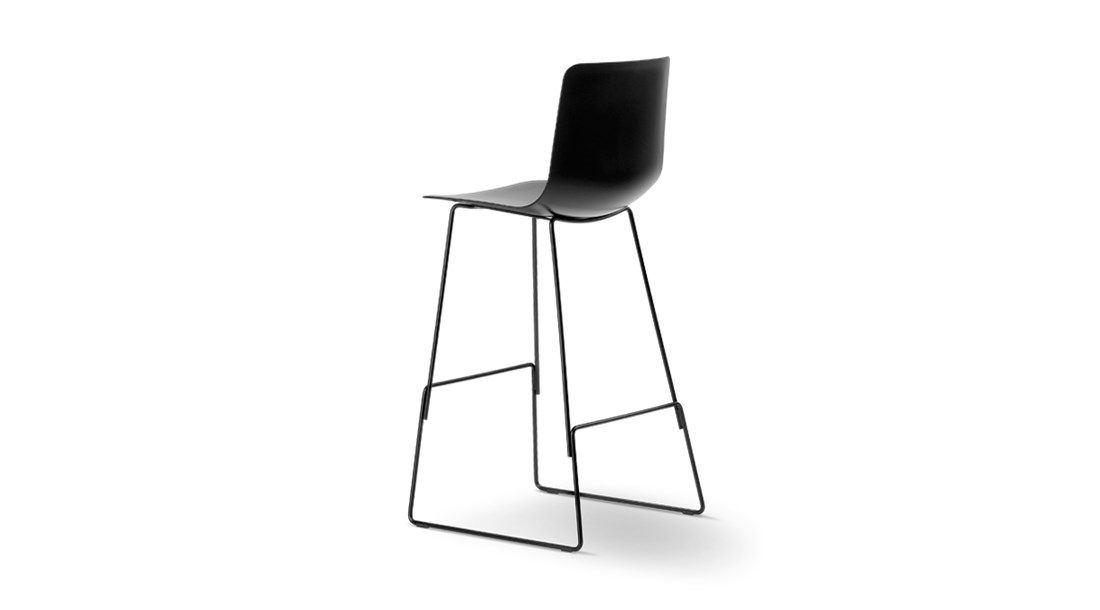 Pato Sledge Barstool - Pato is a carefully crafted multipurpose chair in eco-friendly polypropylene that can be used outdoors. The chair is available with a range of optional features including coupling. The chair can be tuned from basic to exclusive with optional upholstery.  Pato is a prime example of our focus on sustainability and protecting the environment, reflected in a chair that's 100% renewable and recyclable. All components can be incorporated into future furniture production, thus contributing to a circular economy by minimising the use of materials, resources, waste and pollution.   Merging traditional production methods with cutting-edge technology, Pato is a human-centric, highly versatile series of multi-purpose functional furniture that draws on our in-depth experience with materials, immaculate detailing and heritage of fine craftsmanship. Allowing us to apply our high standards of texture, finish and carpentry techniques to an array of materials in addition to wood for products aimed at a mass market.   With its clean lines and curves, Pato echoes the ethos of Danish-Icelandic design duo Welling/Ludvik. Demonstrating their belief that good design has the ability to be interesting, even when reduced to its most simple form. Where anything extraneous is eliminated and every detail has a purpose.   Together we spent nearly three years developing the shell structure to have a soft surface that's also wear and tear resistant. Enhancing the chair's ability to optimally conform to the user's body is a subtle beveled edge. A technique from classic cabinetmaking, which gives the chair a sense of handcrafted finesse. Each Pato is detailed and finished by hand by our highly skilled crafts people, who refine the beveled edge and the silky, resilient surface. Setting a new standard for the execution and finish of polypropylene.   Since the success of its initial launch, we've expanded Pato into an extensive collection of variants, featuring armchairs, barstool