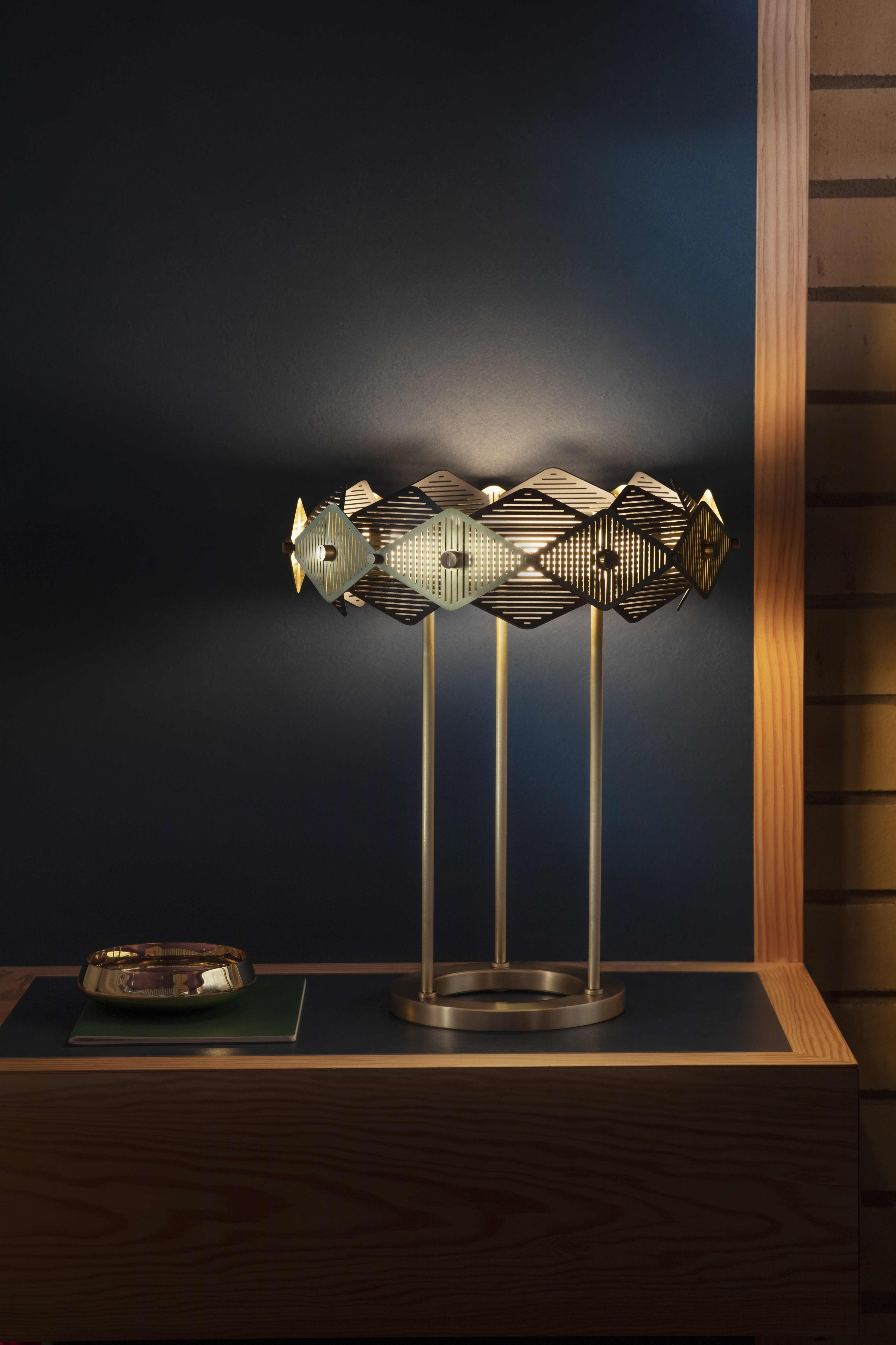 Rote Table Lamp - <p><span>This intricate and petite version of the Rote shade is held aloft by three brass rod stems and fixed to a solid brass cylindrical base. Geometrically satisfying it demands attention.</span></p>    Matter of Stuff
